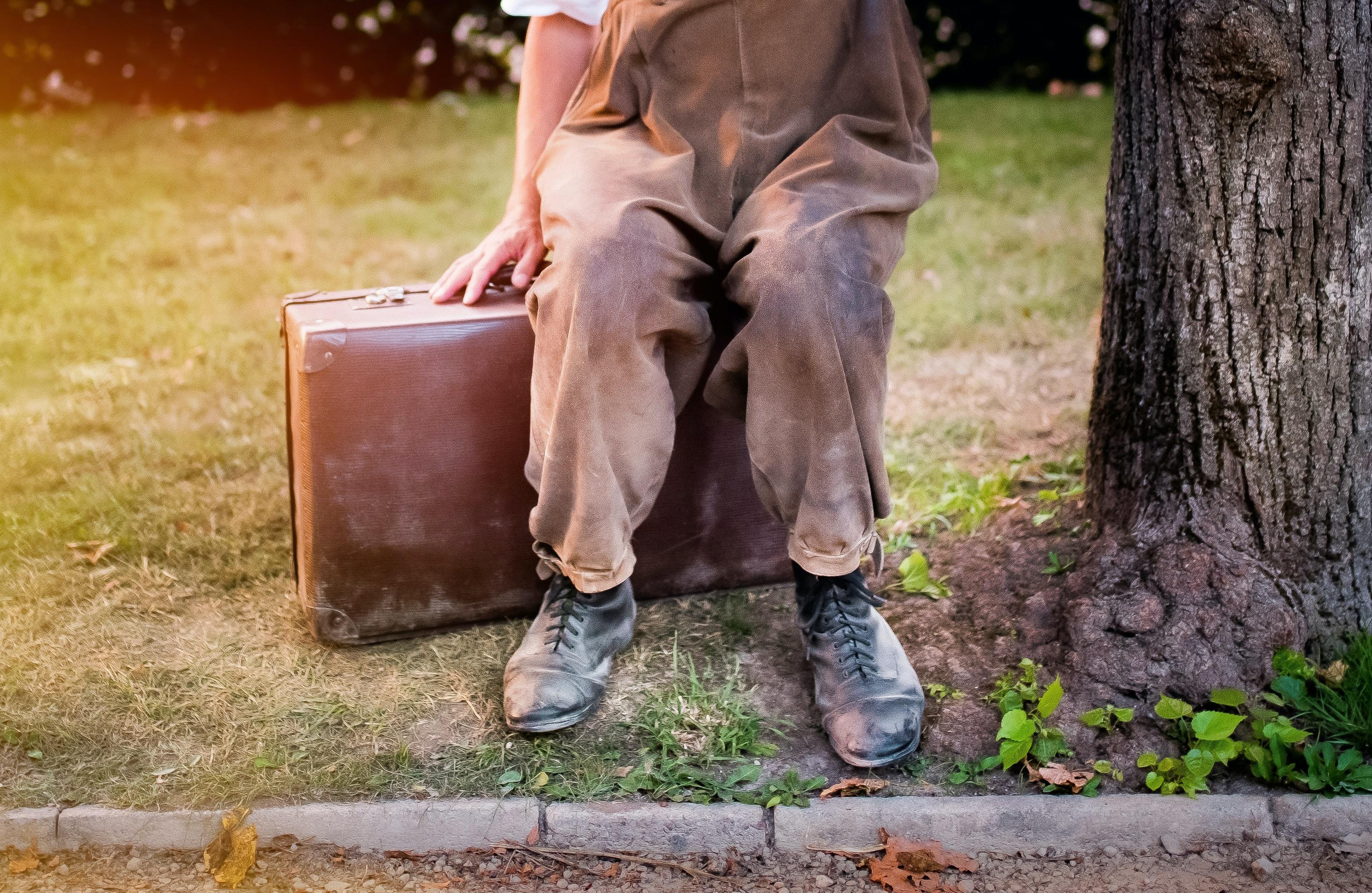man sitting on attache case