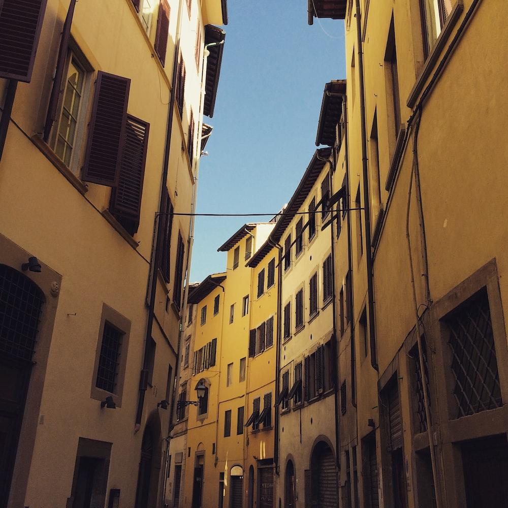 brown concrete buildings under blue sky