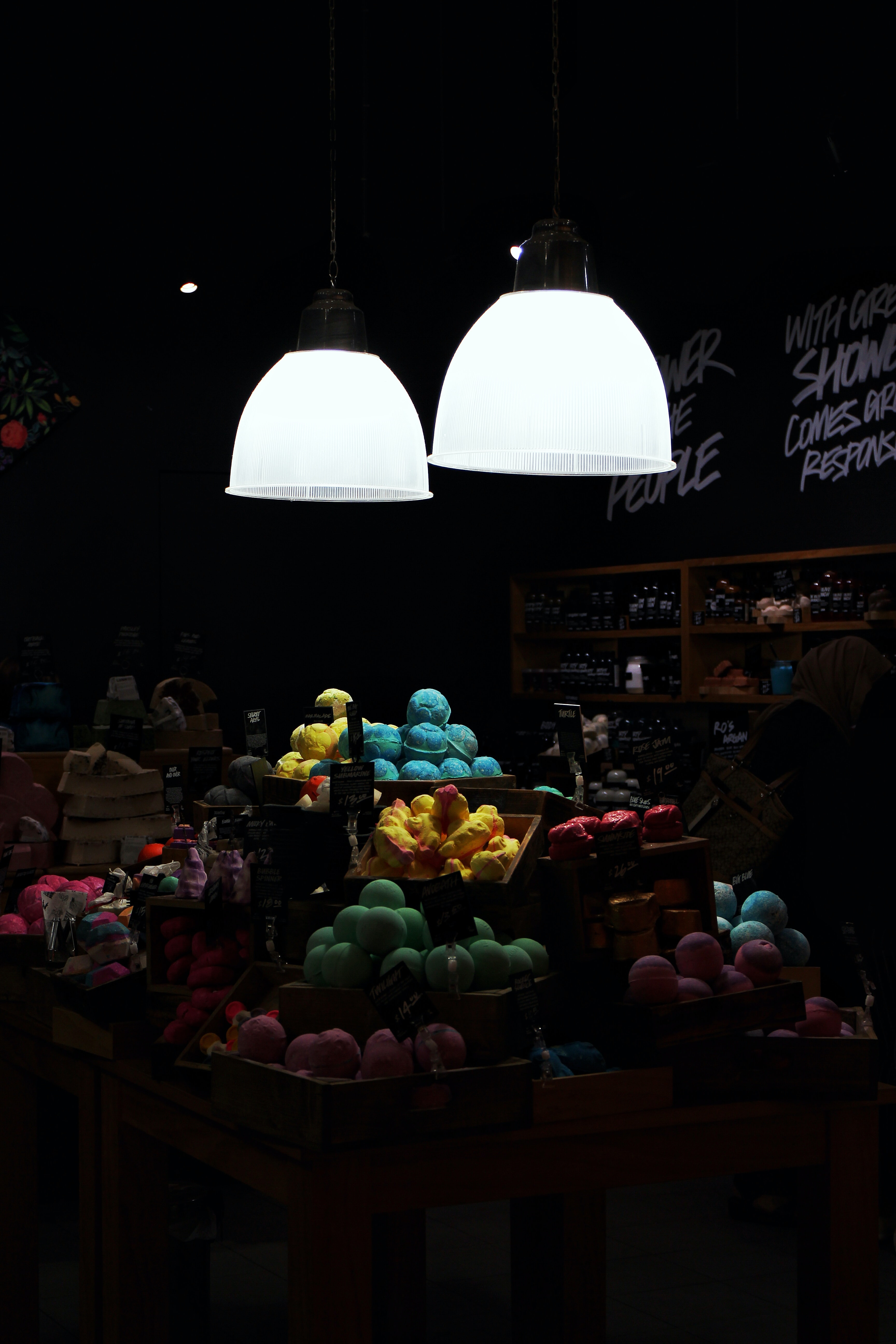 variety of pastries with turned on pendant lamps