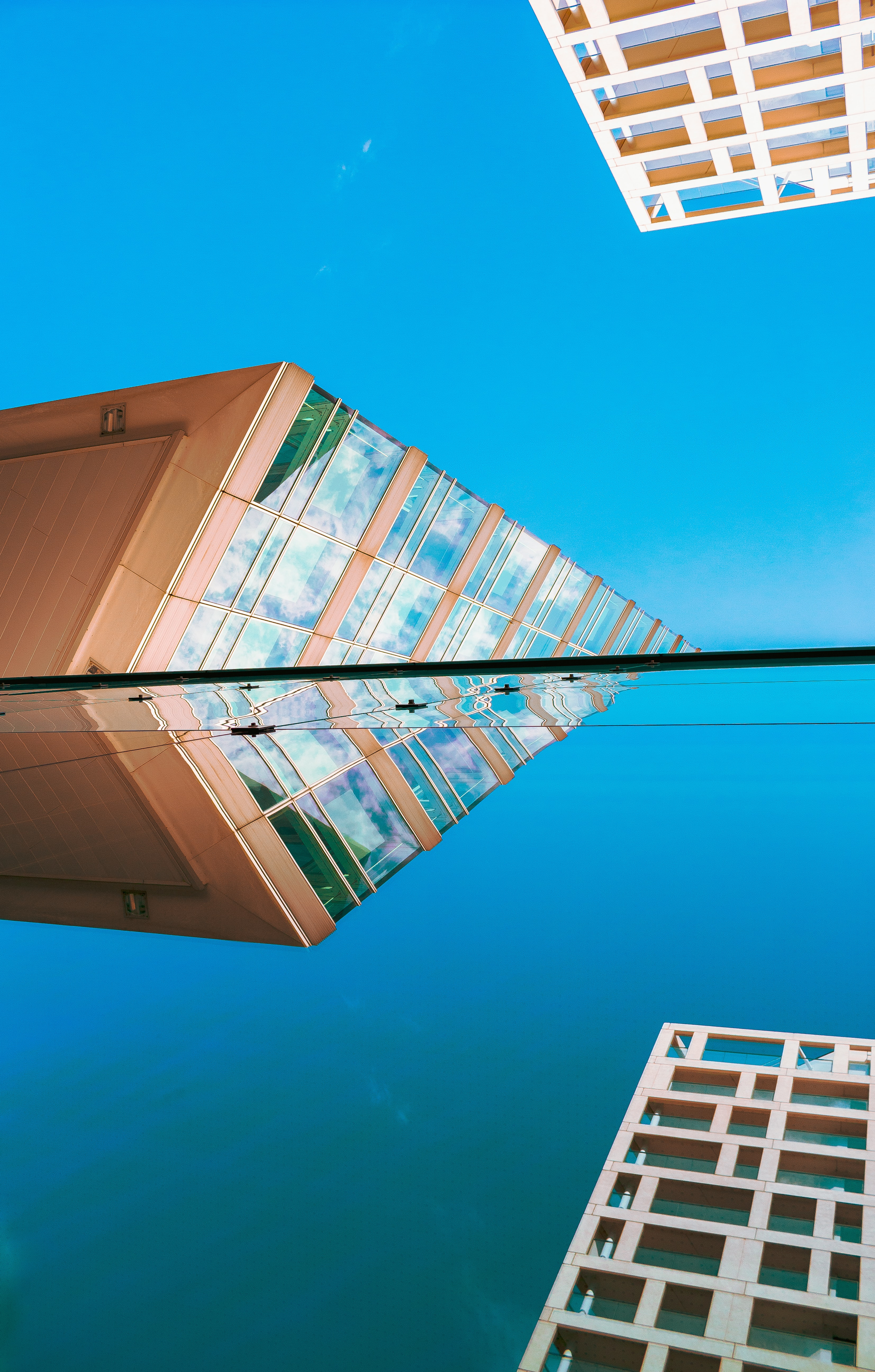 reflection of building on glass window during daytime
