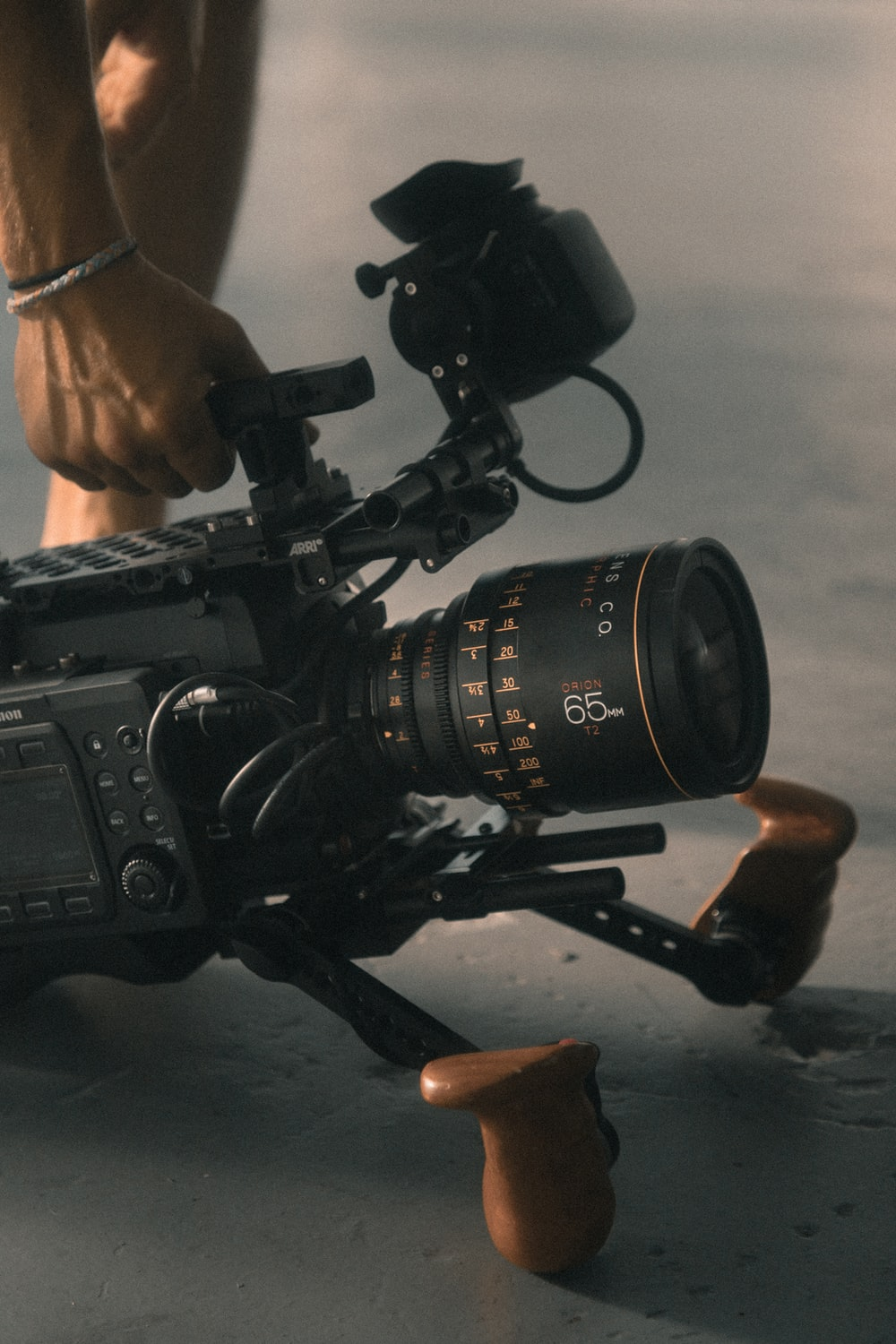 person holding video camera with stablizer
