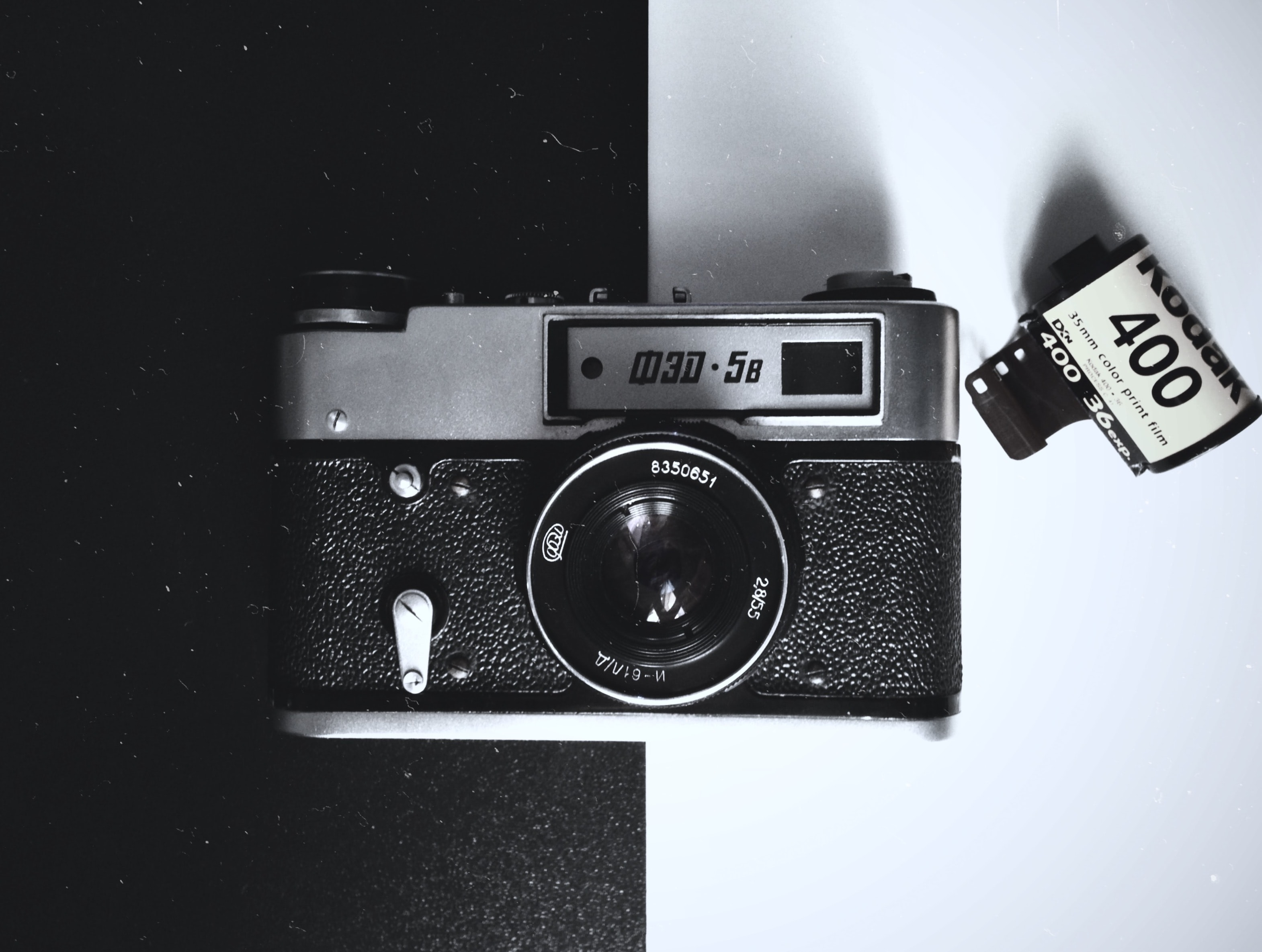 black and gray film camera on white and black board