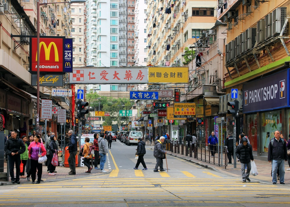 people walking on the road near buildings