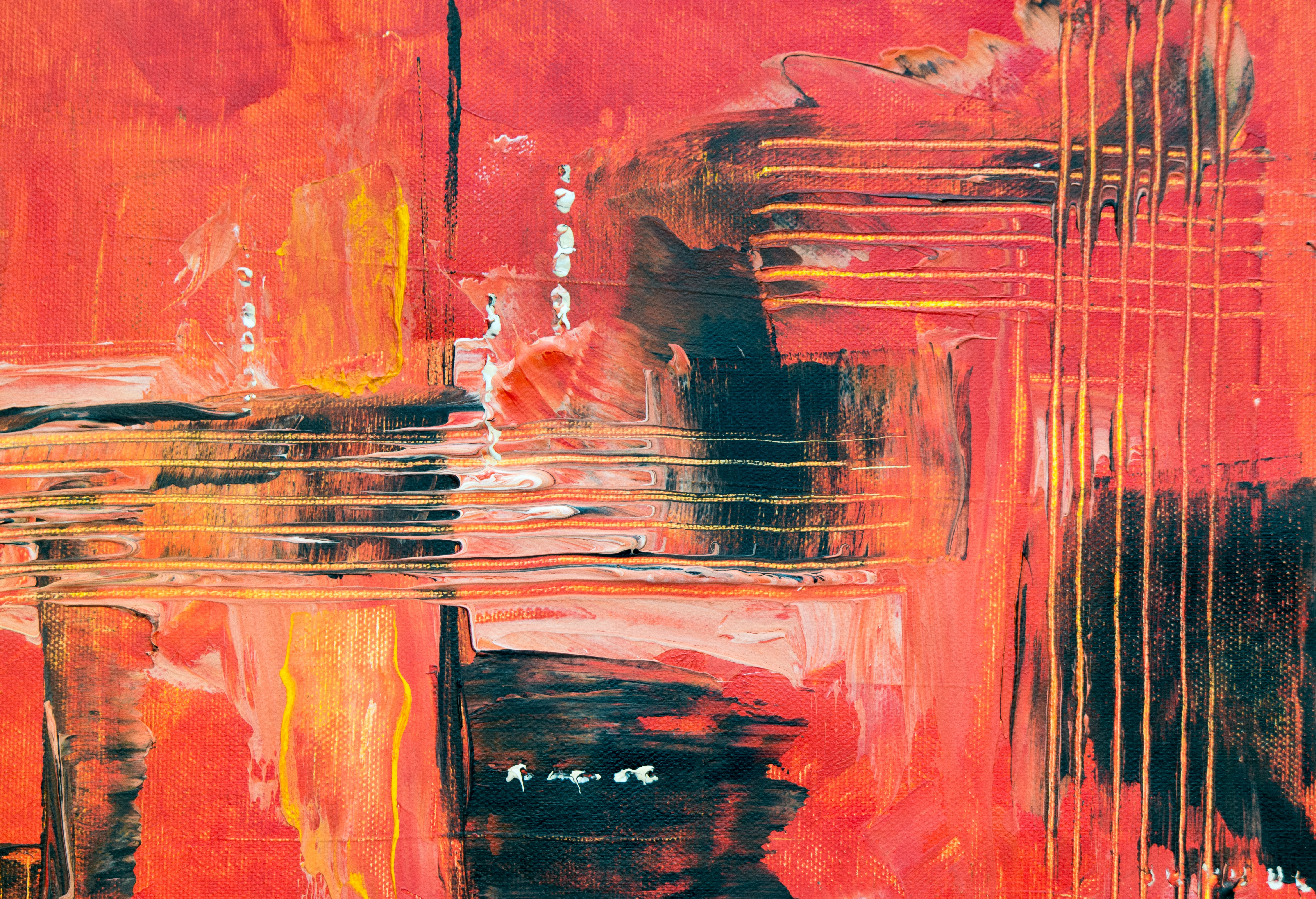 red, black, and yellow abstract painting