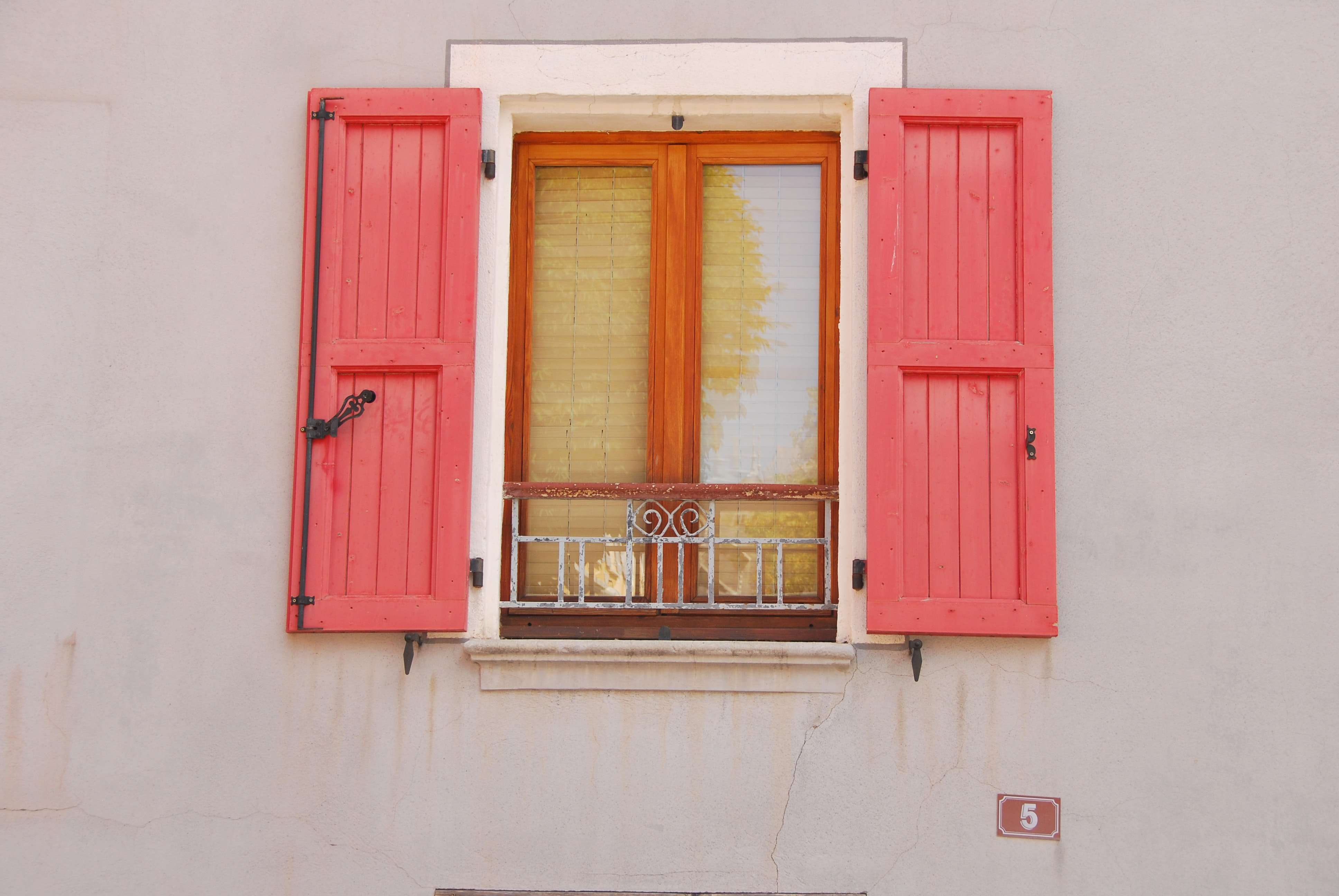 opened red wooden window doors