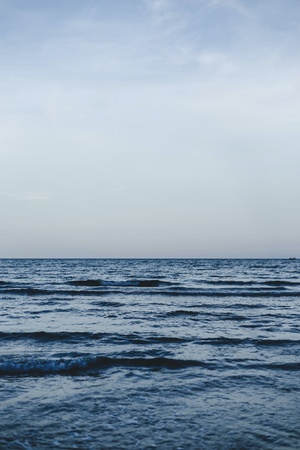 calm sea under clear blue sky during daytime
