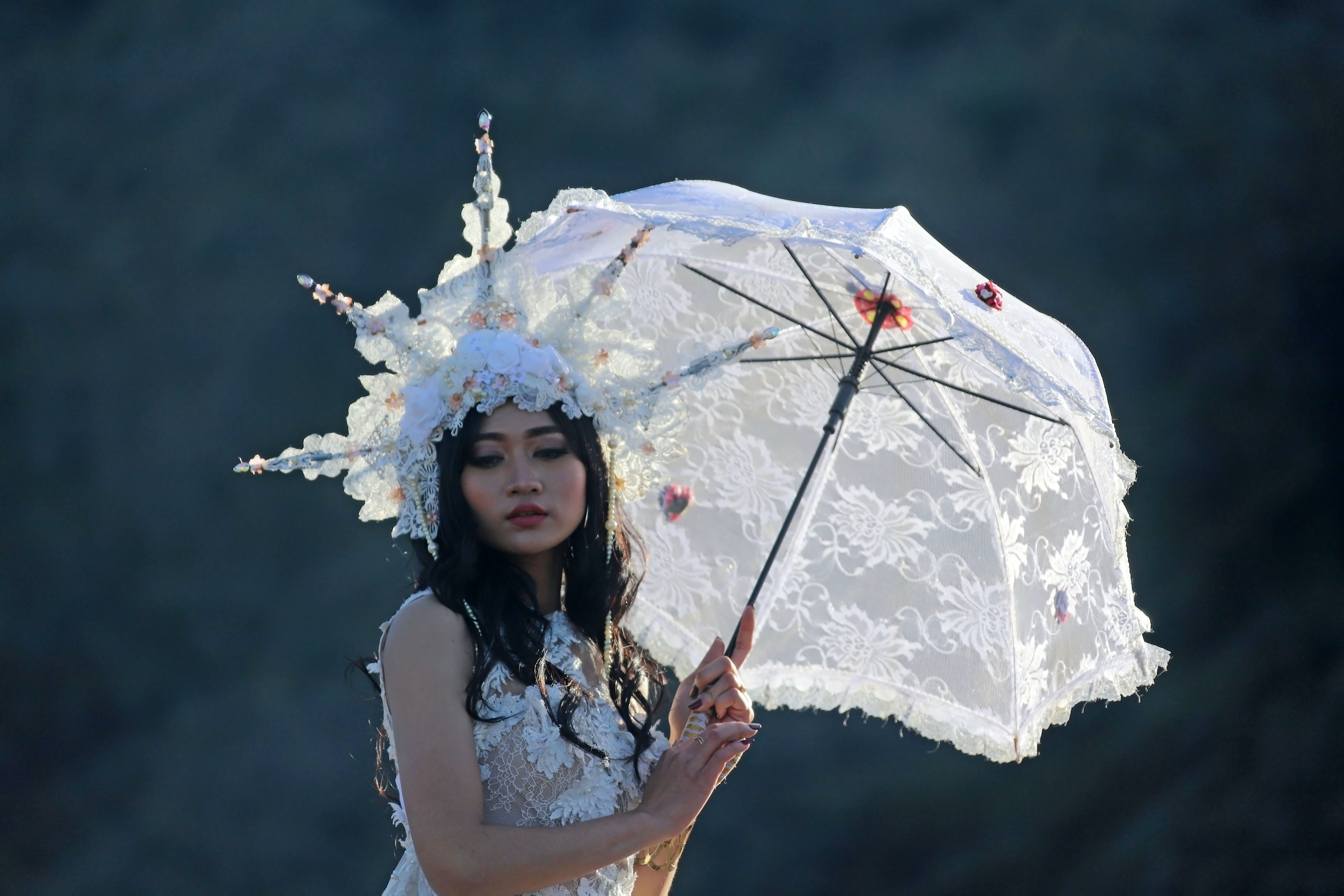 woman carrying white umbrella