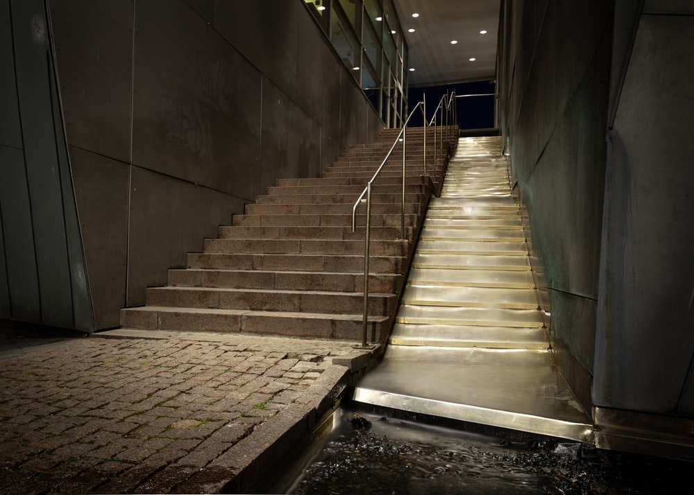 gray concrete staircase with stainless steel railings