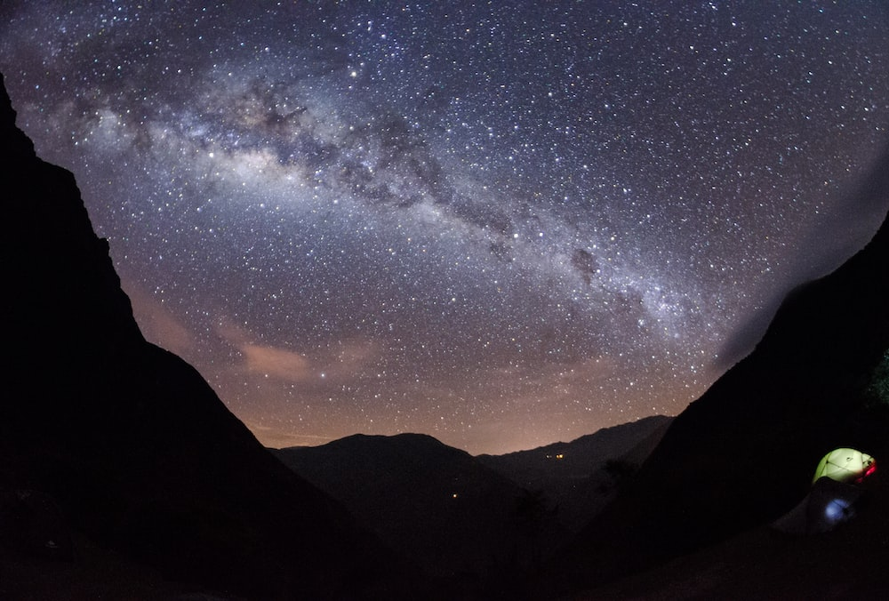 milky way over mountain wallpaper