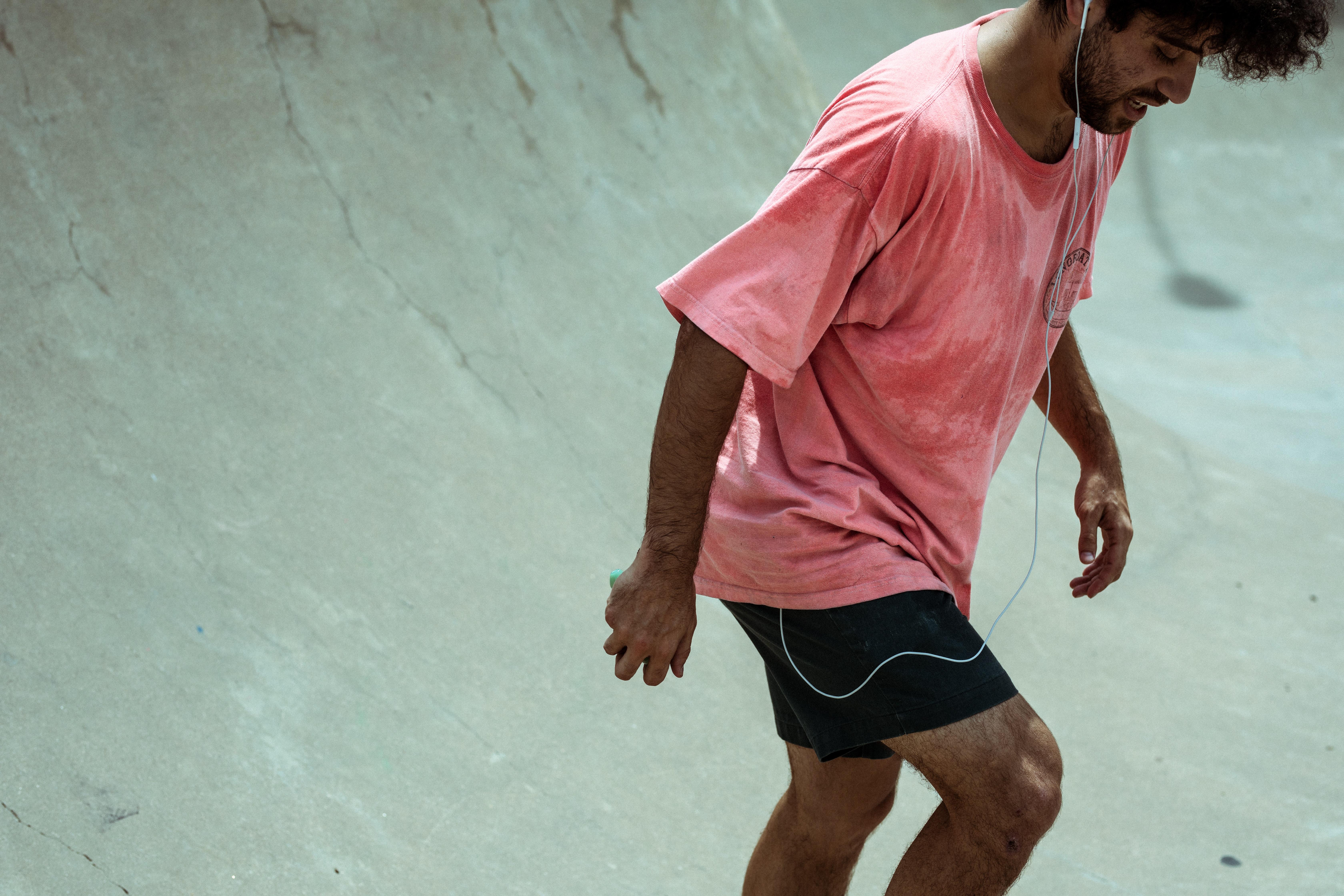 man standing on skateboard track