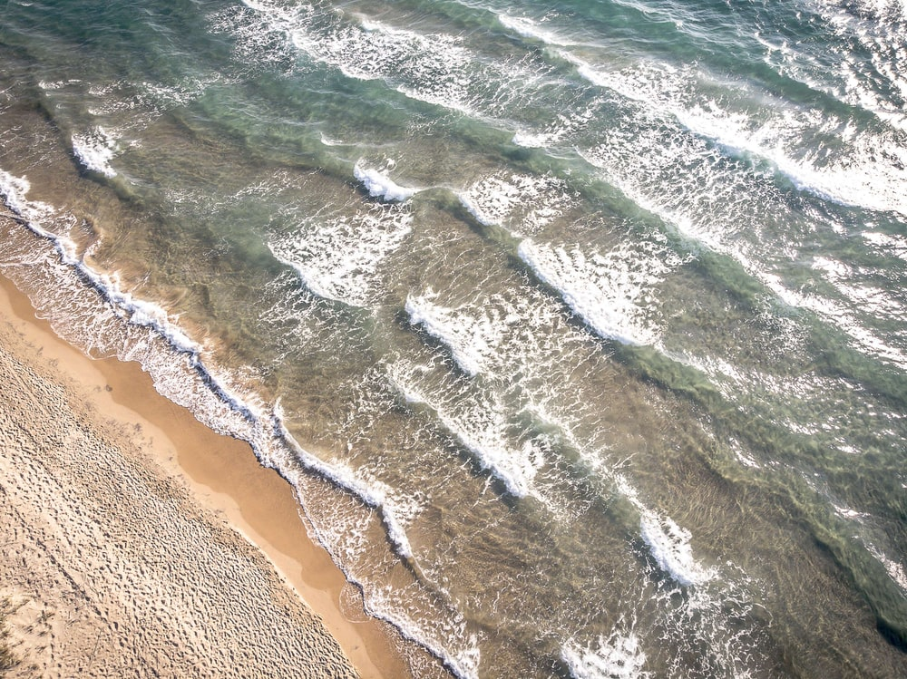 aerial view of water wave on shore