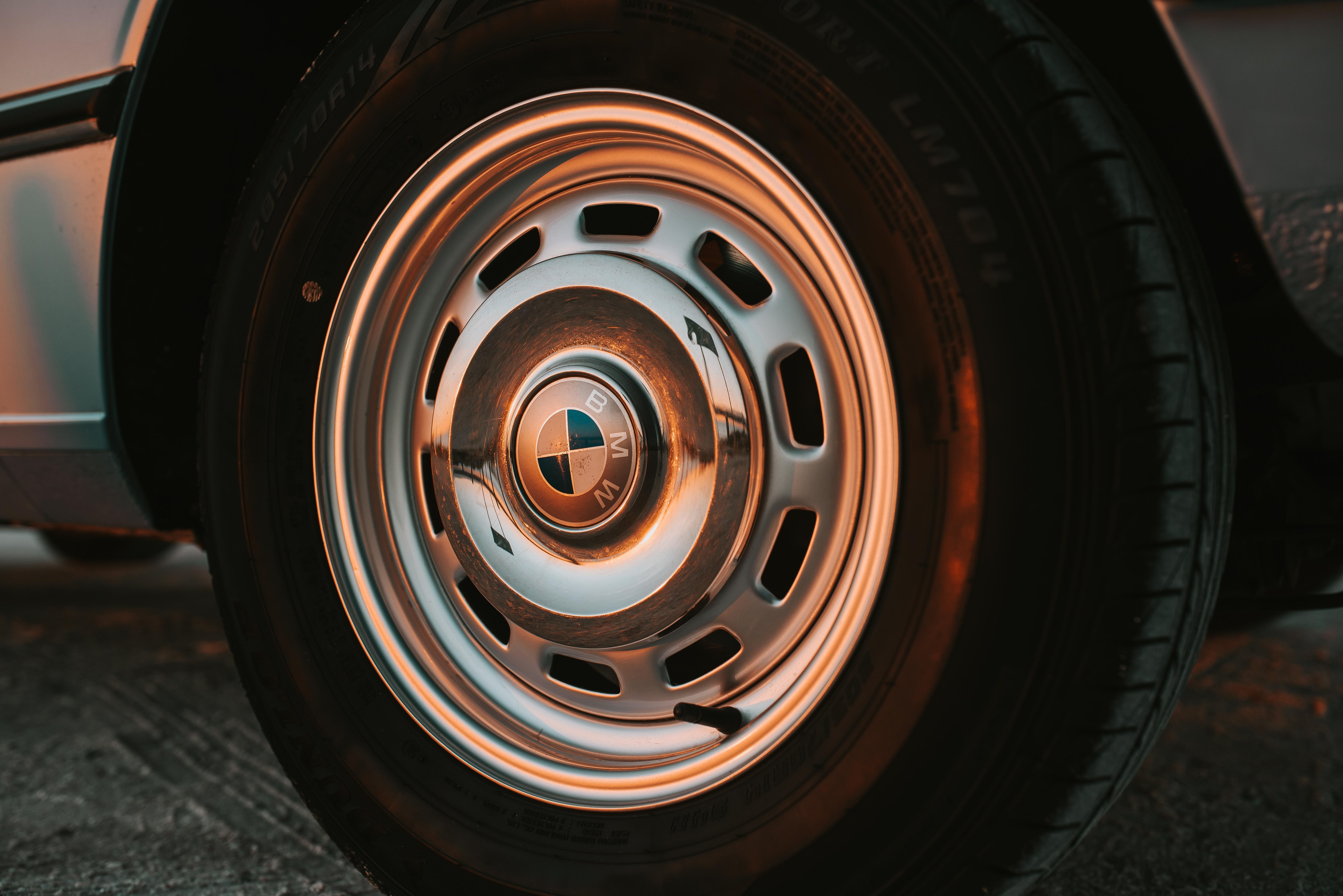 closeup photo of chrome BMW vehicle wheel and tire