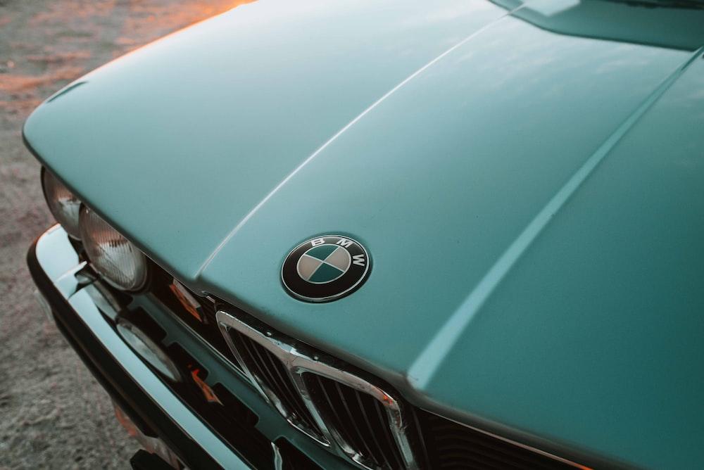 green BMW sedan during daytime