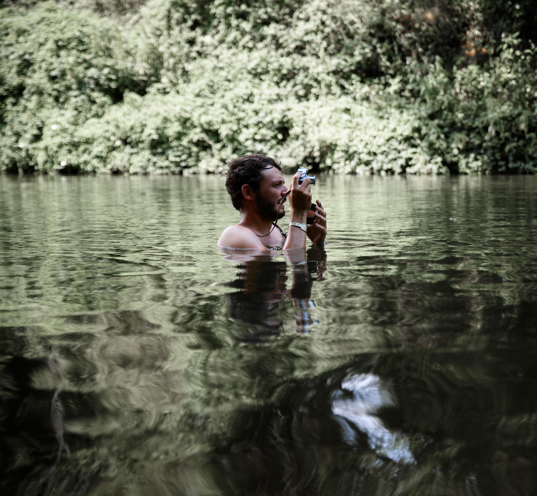 man taking photo on body water