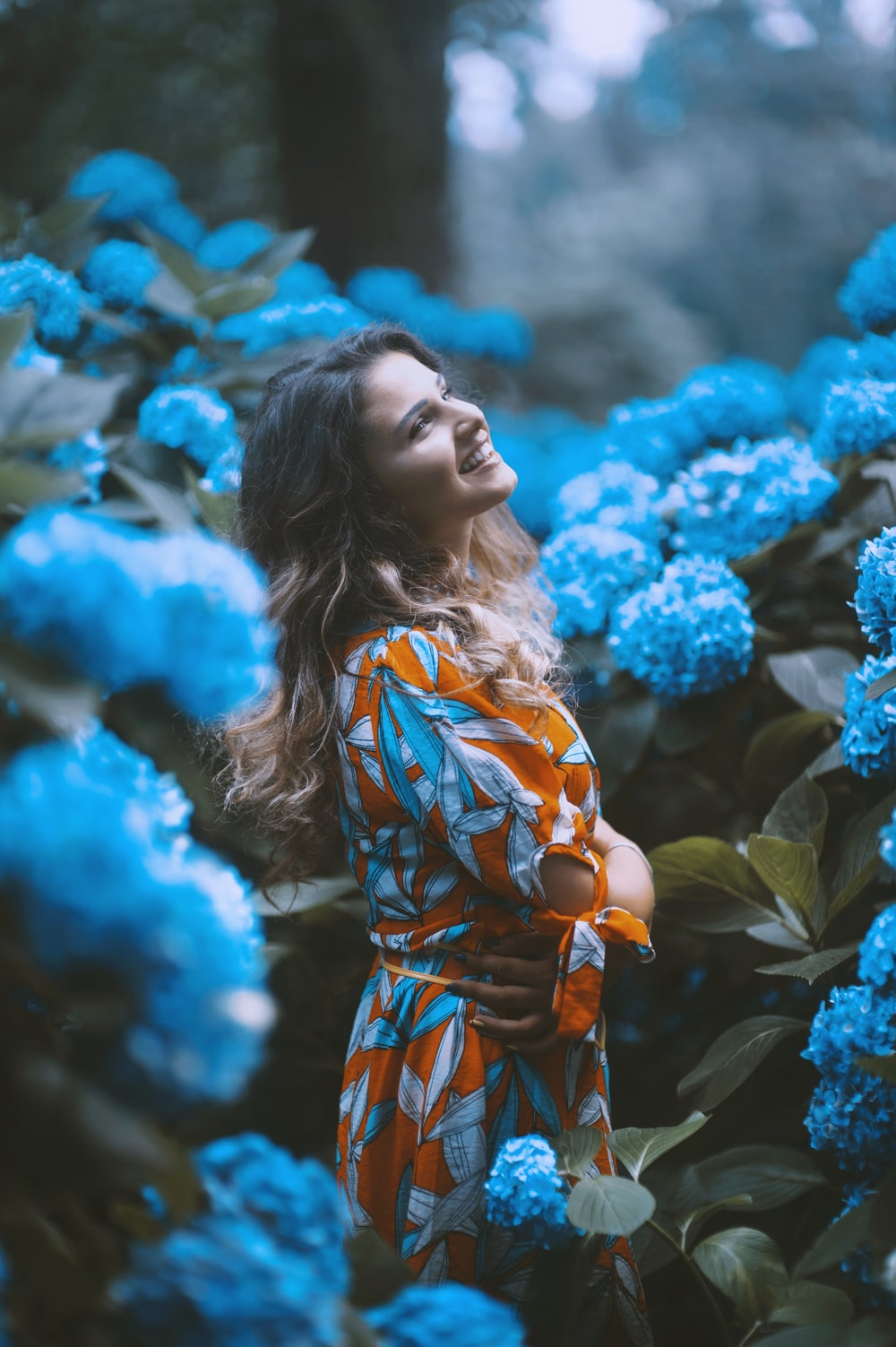 woman standing infront of flowers