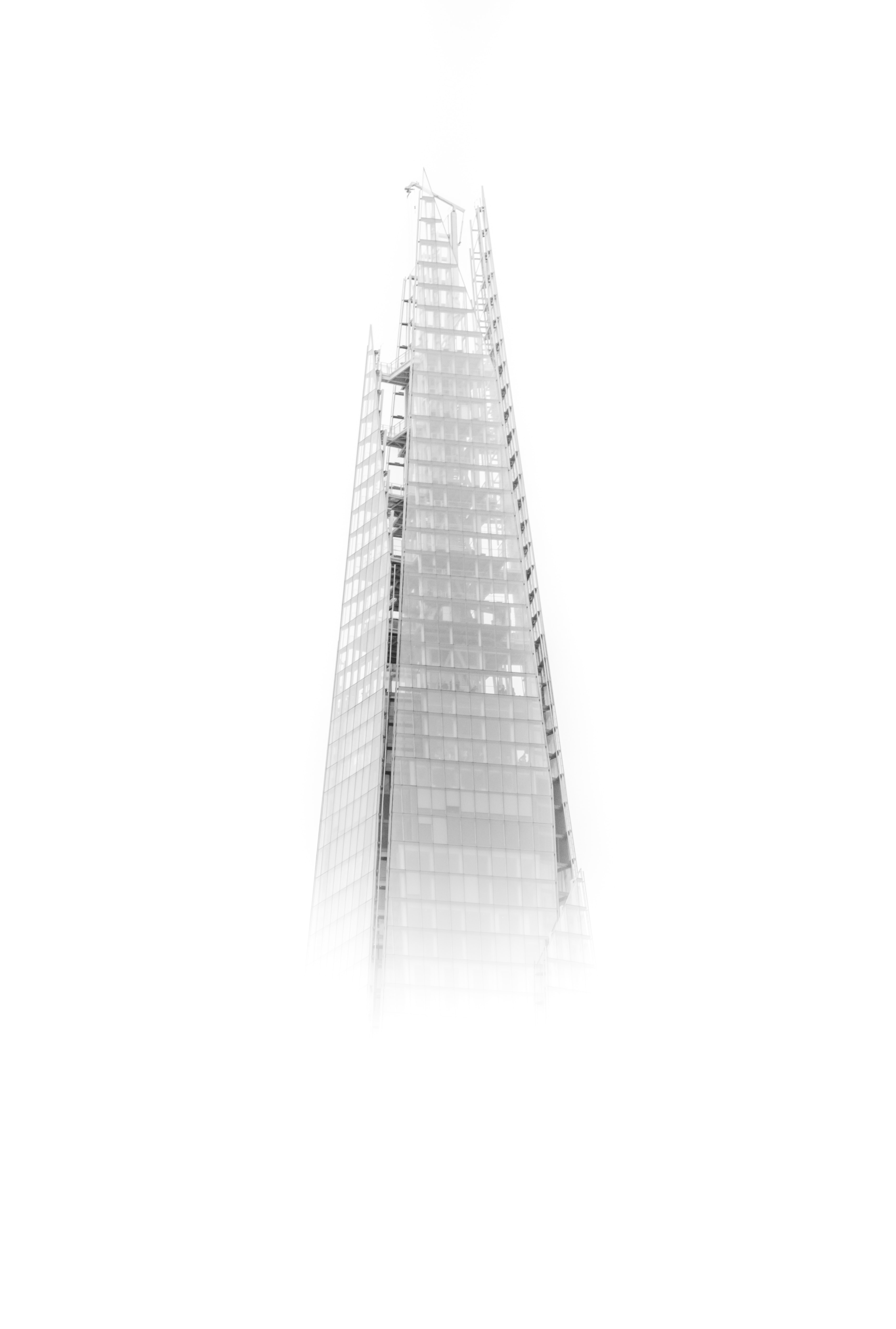 high-rise building with fogs