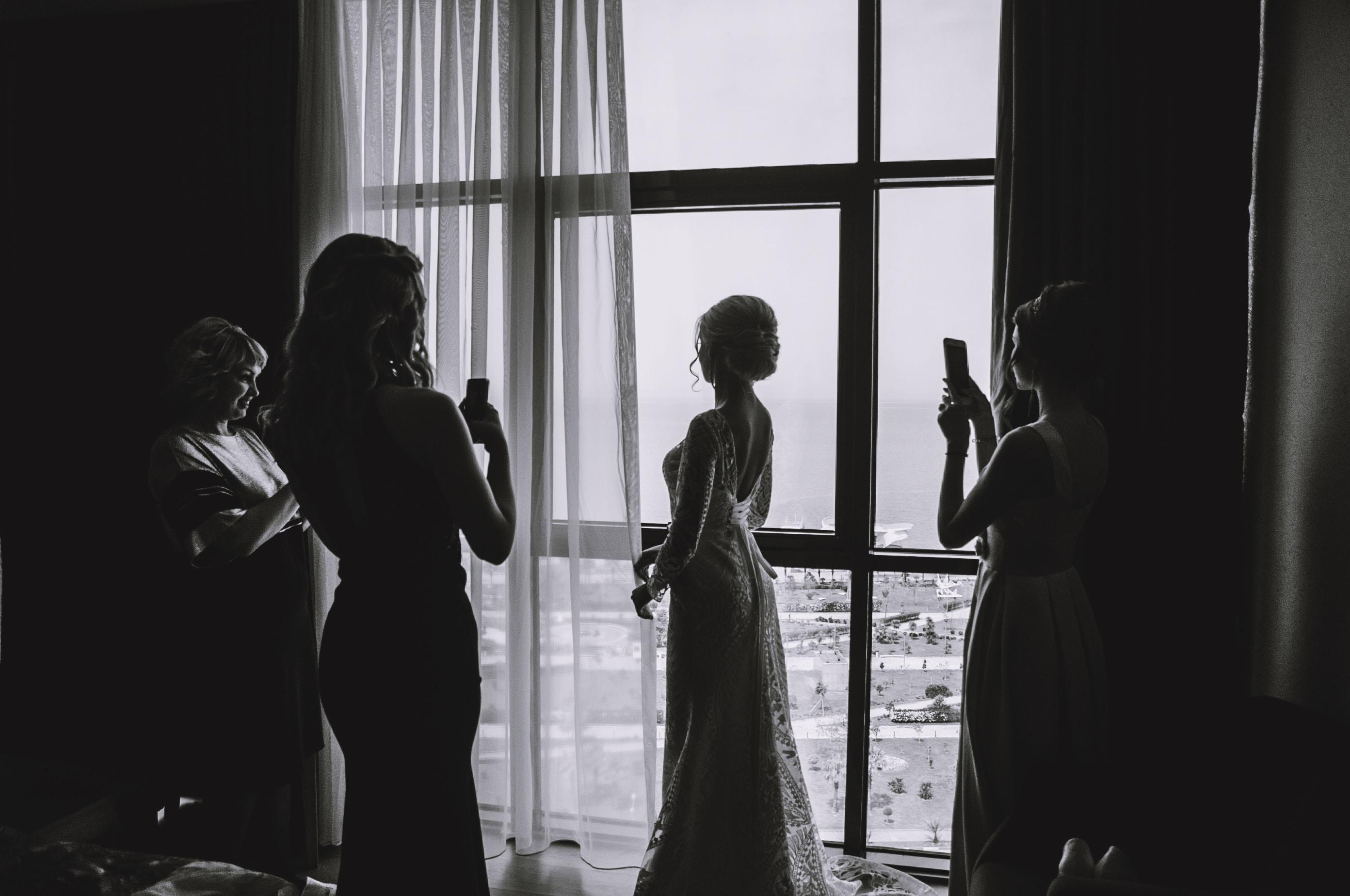 silhouette of woman wearing wedding dress