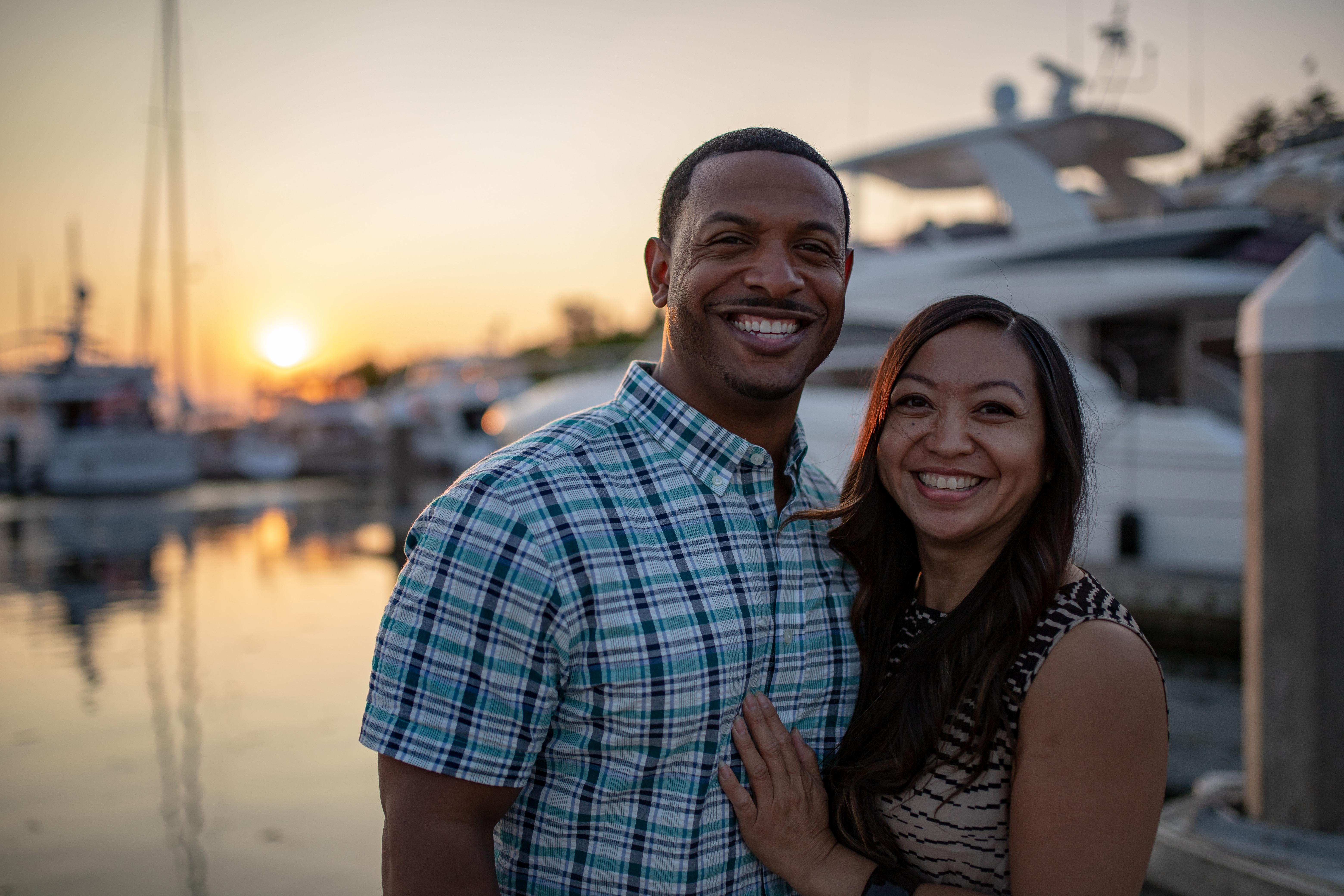 man and woman near white yacht