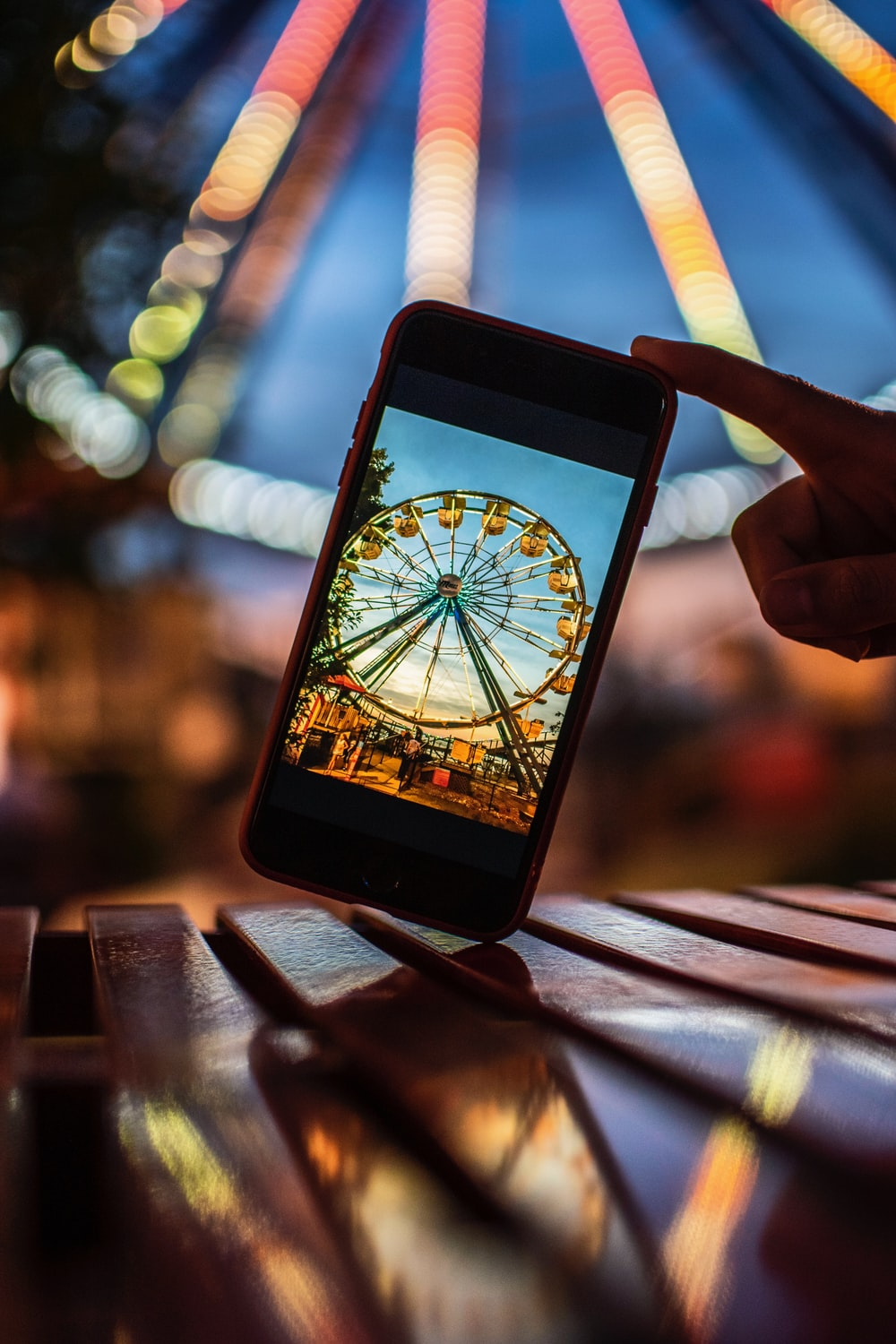closeup photography of smartphone displaying ferris wheel