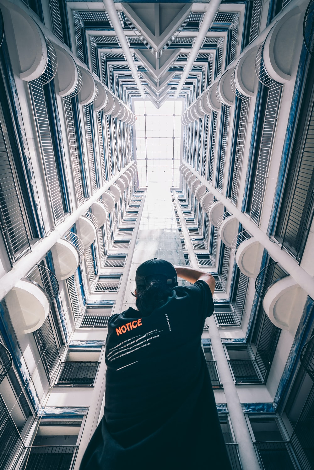 man in black T-shirt standing inside building