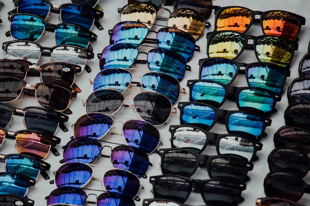 black sunglasses lot on white panel