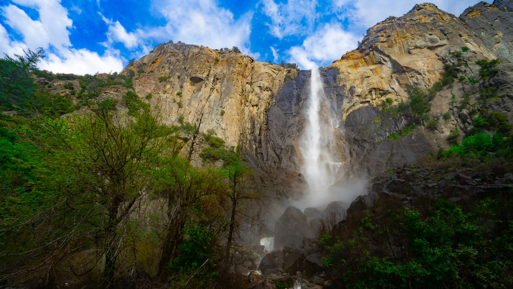 low angle photography of waterfalls at daytime