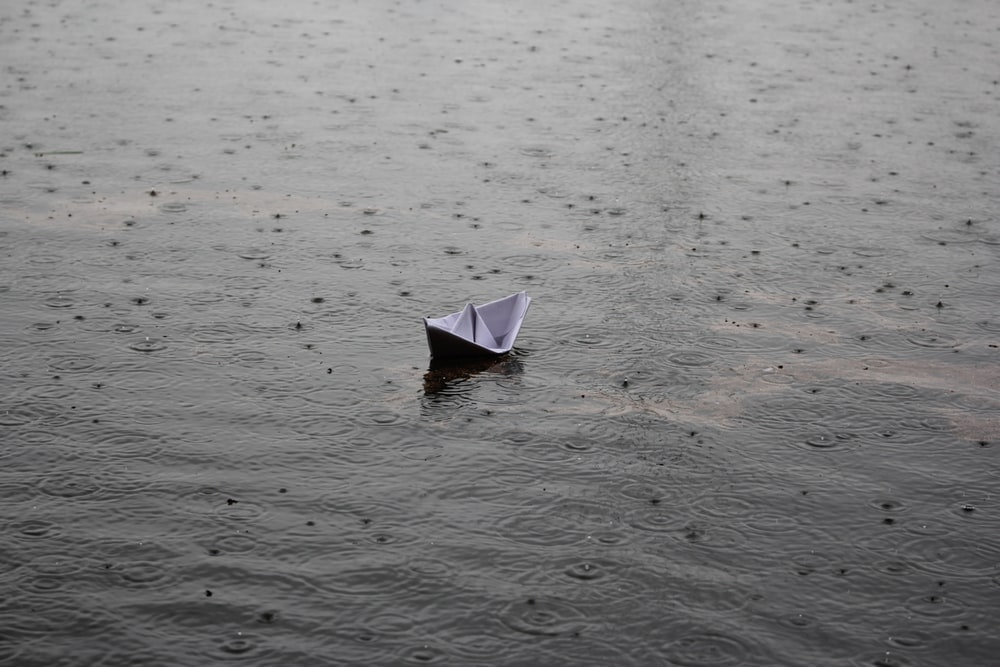 paper boat on body of water