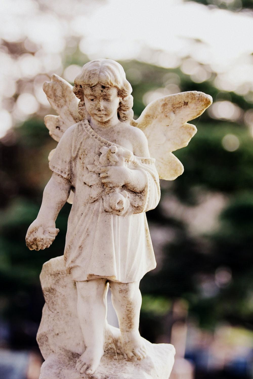 white concrete angel sculpture