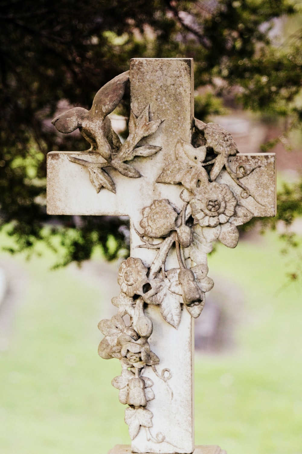 beige and white floral concrete cross