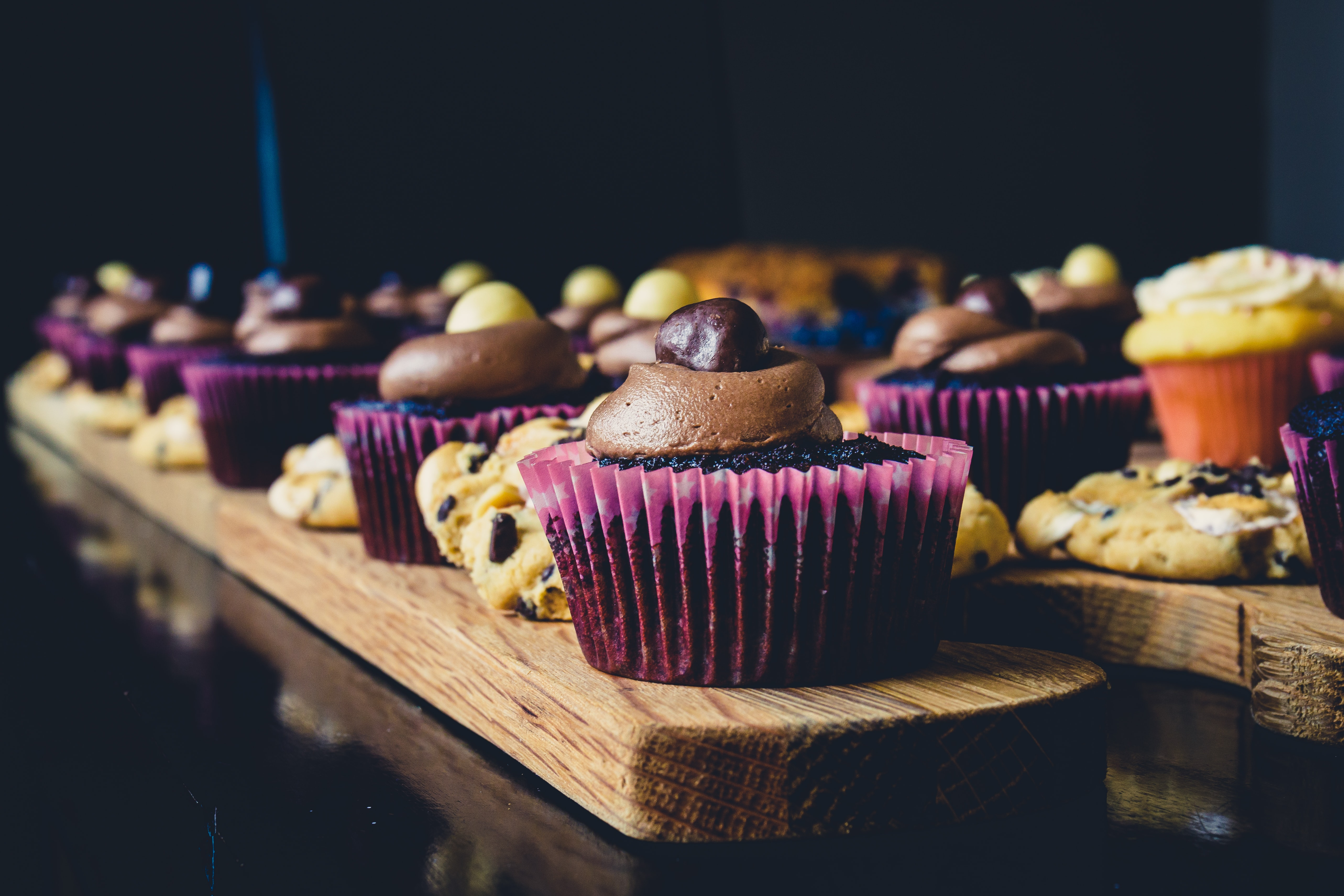 baked cupcakes on brown wooden table