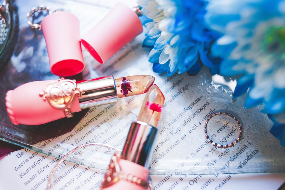 two clear and red lipsticks