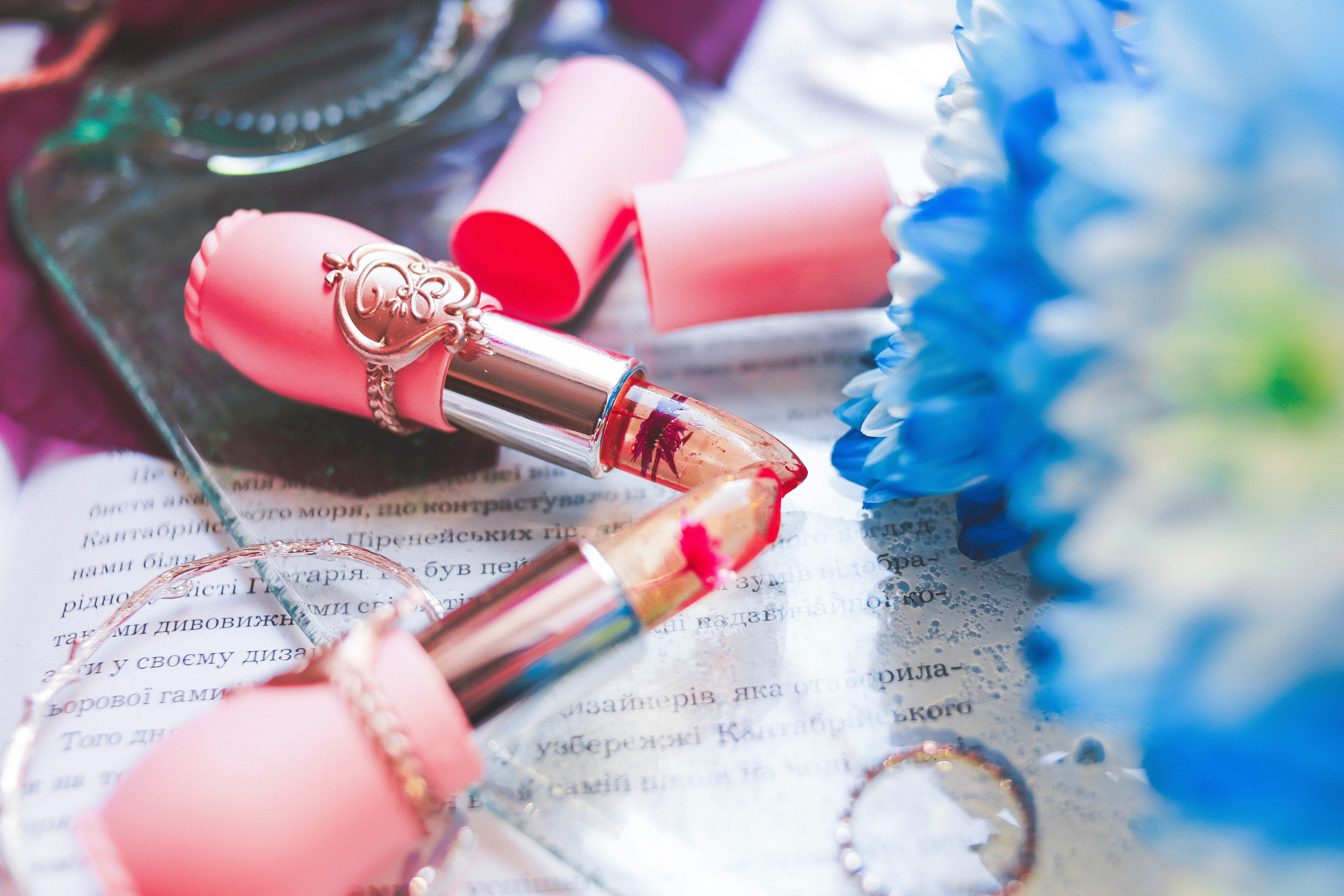 two pink lipsticks on table