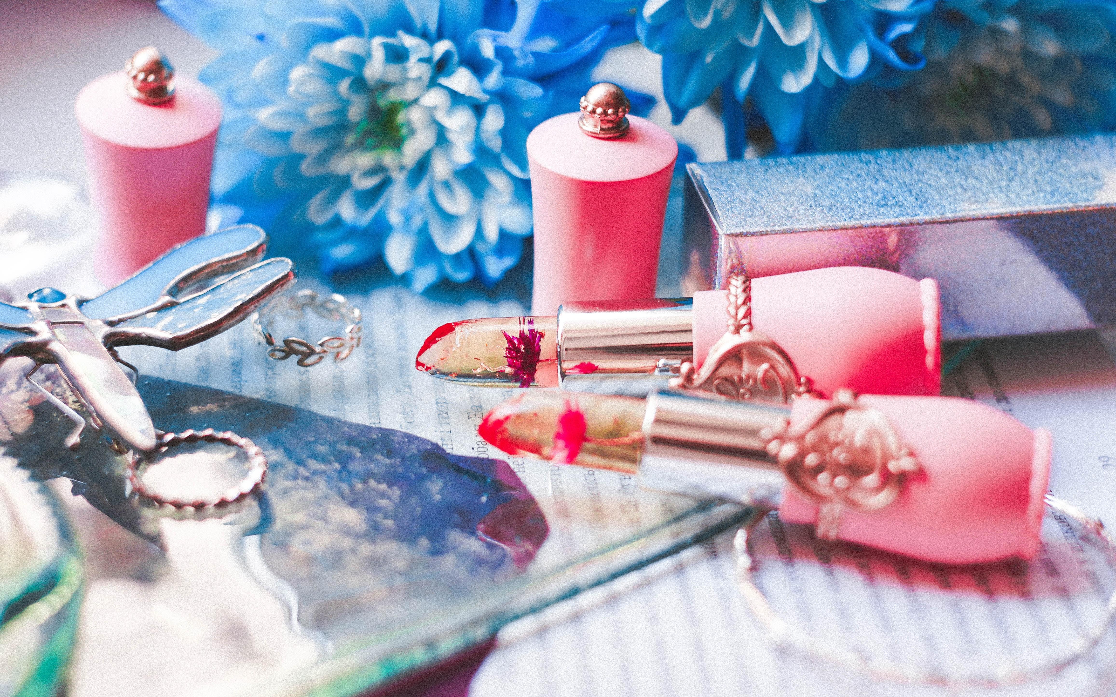 lipsticks beside gray box and bottles