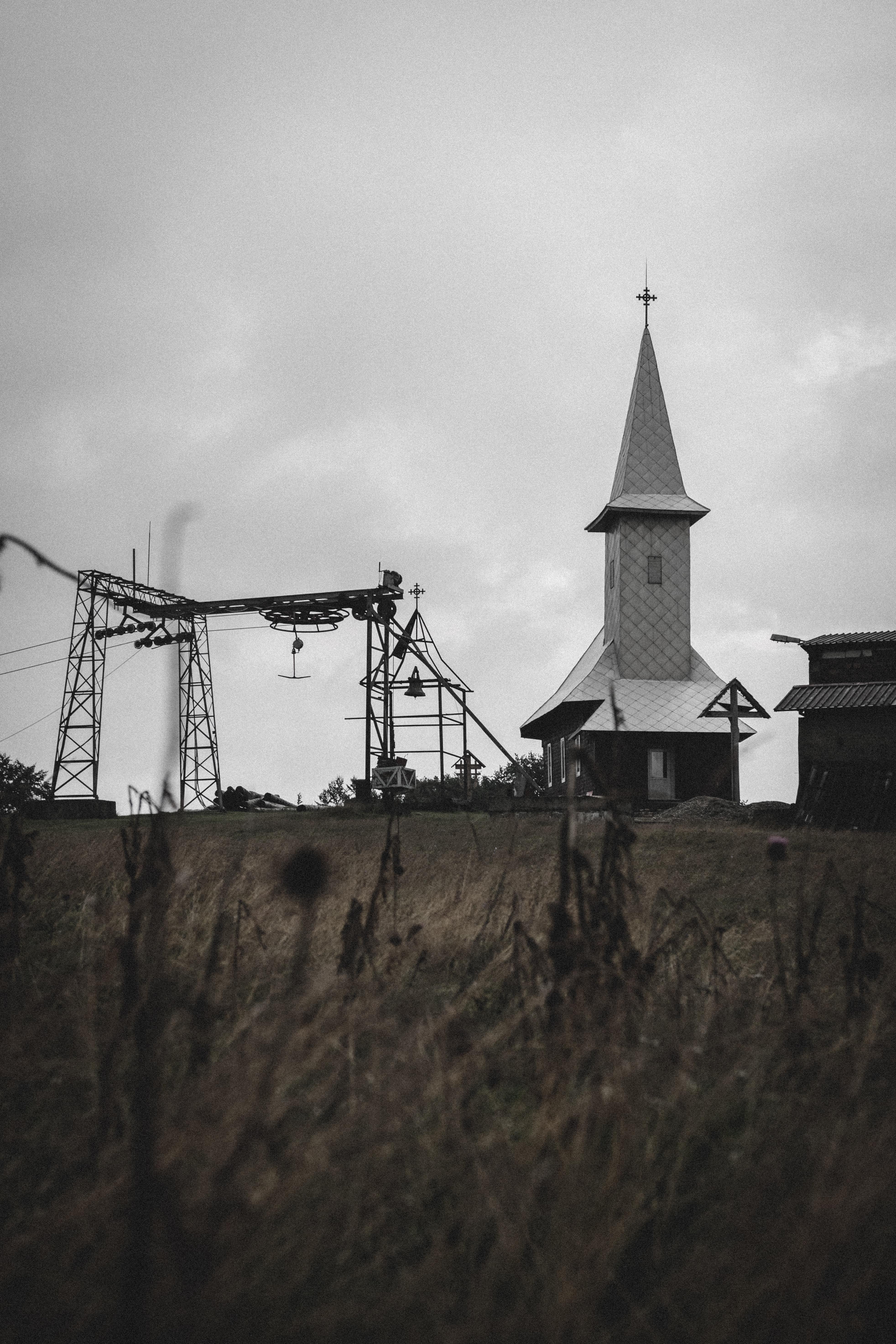 gray chapel on grass field