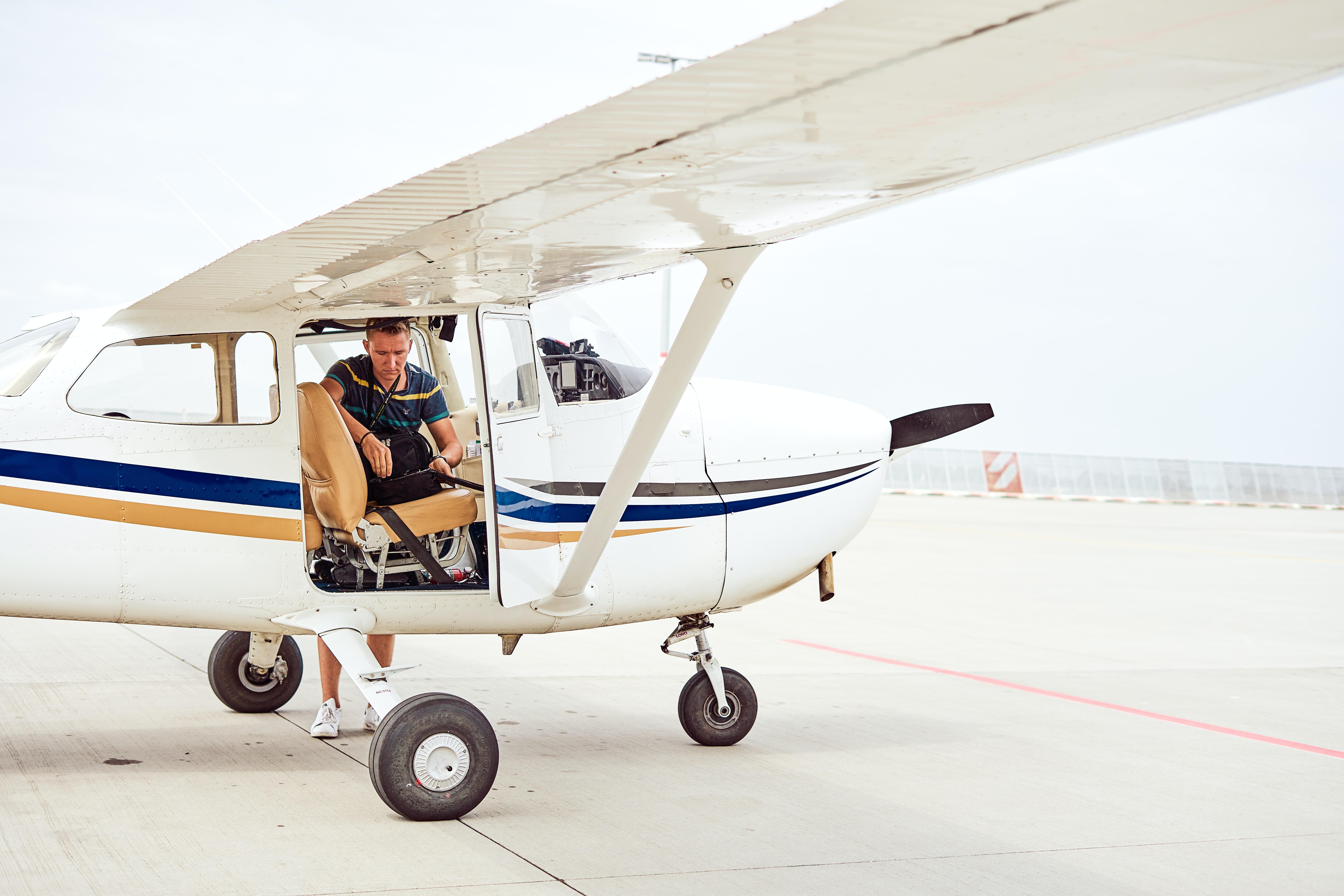man inside of white airplane