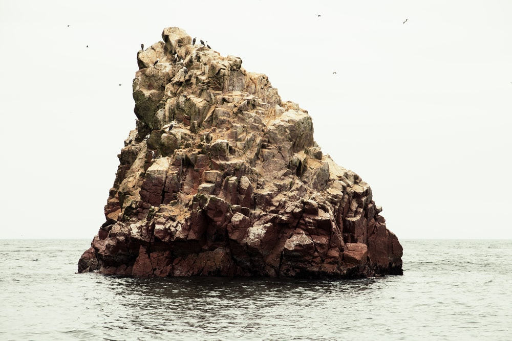 rocky formation near the body of water