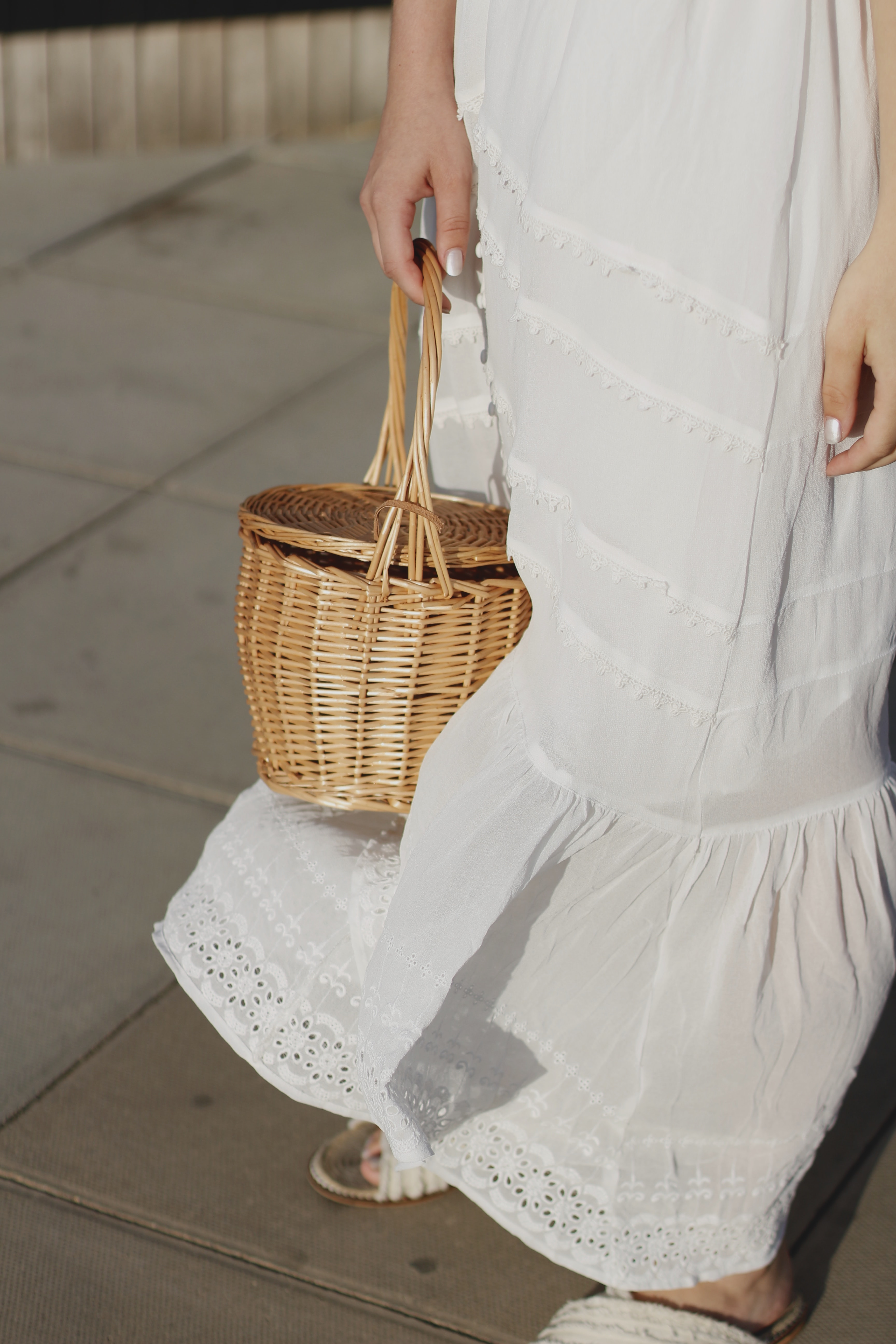 person holding brown wicker basket