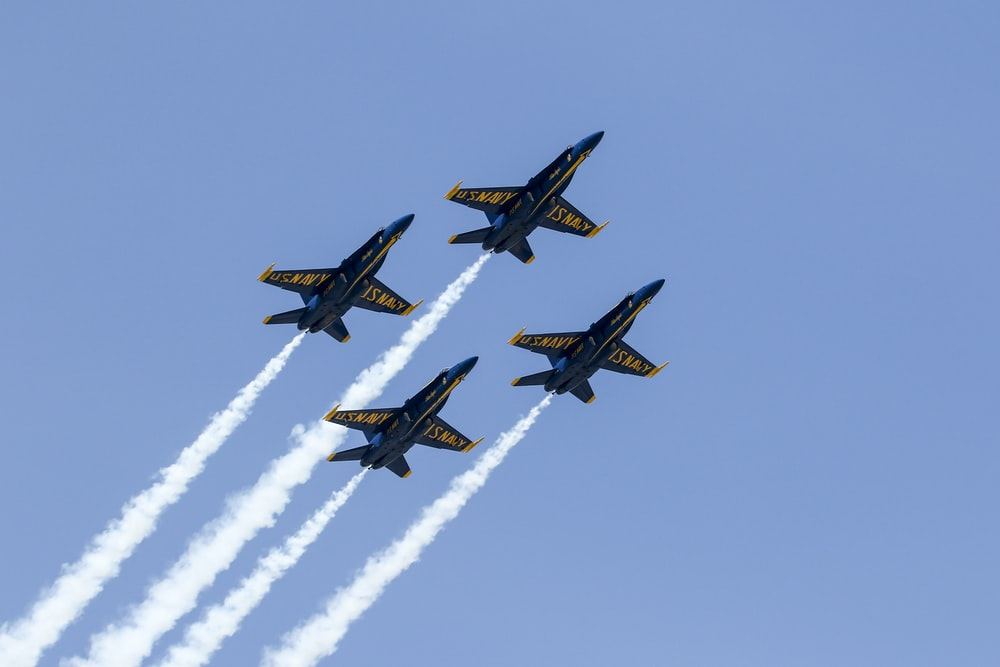 low angle photography of four aircrafts