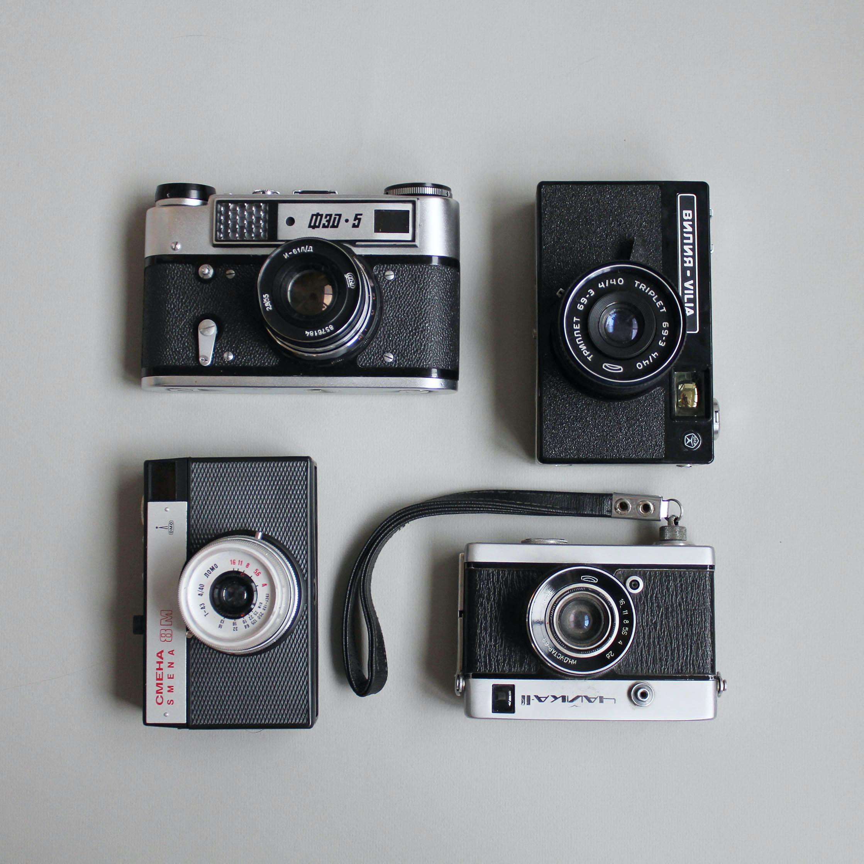 four assorted cameras