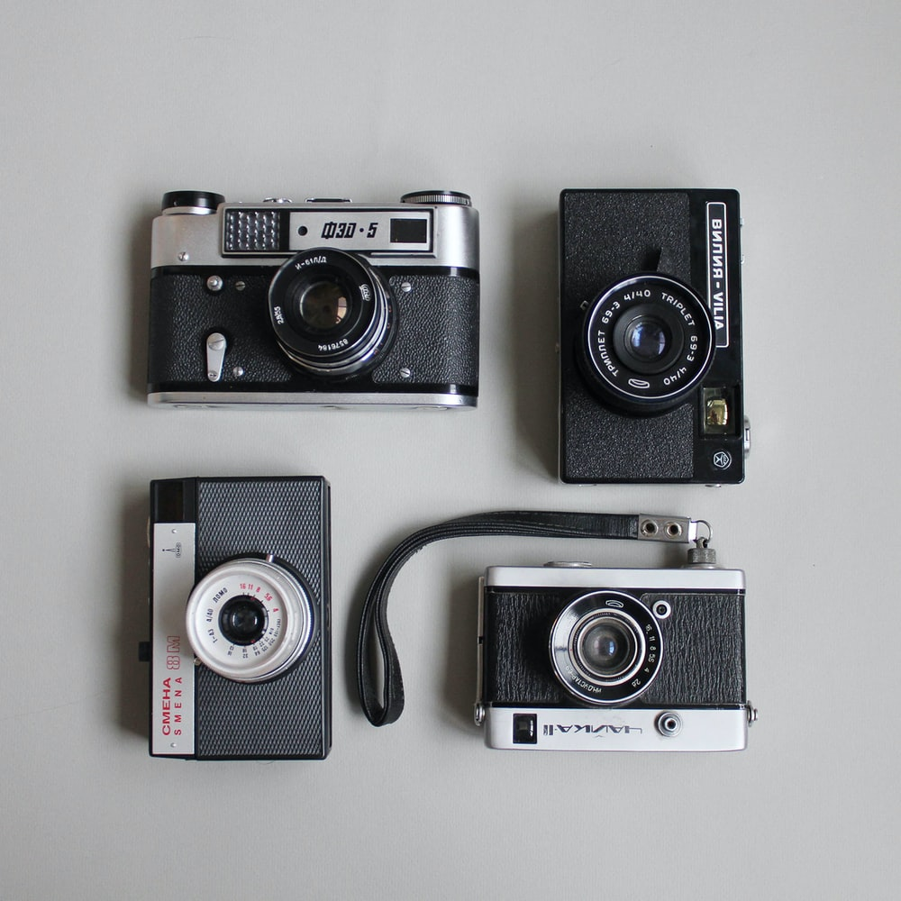 four assorted cameras
