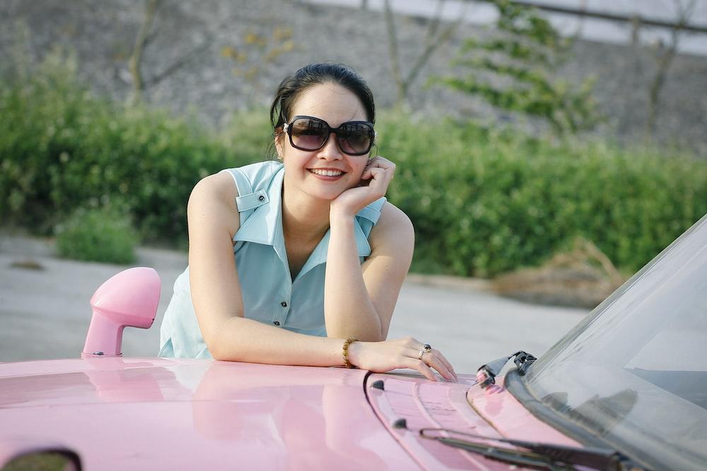 woman wearing blue sleeveless top