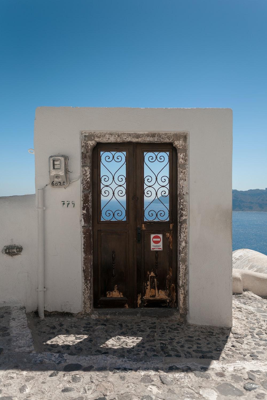 closed brown door facing body of water