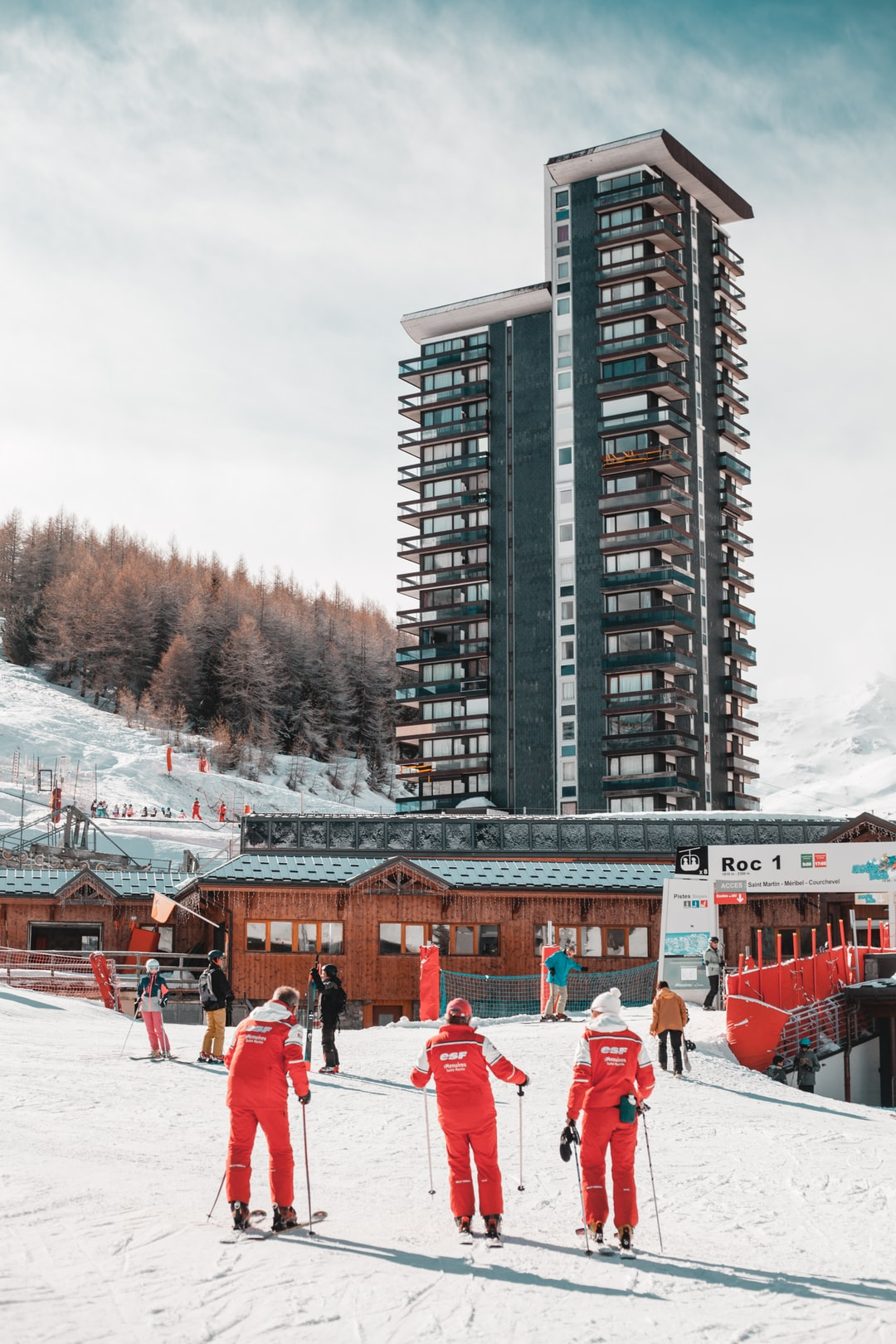 """Every morning at 9am, every groups of ski lessons are meeting at the """"front de neige"""" as we call it at the ski resort. 3 ski instructor are wearing there red dress, an easy way to know they come from the most popular French Ski School ESF (École de Ski Français)."""