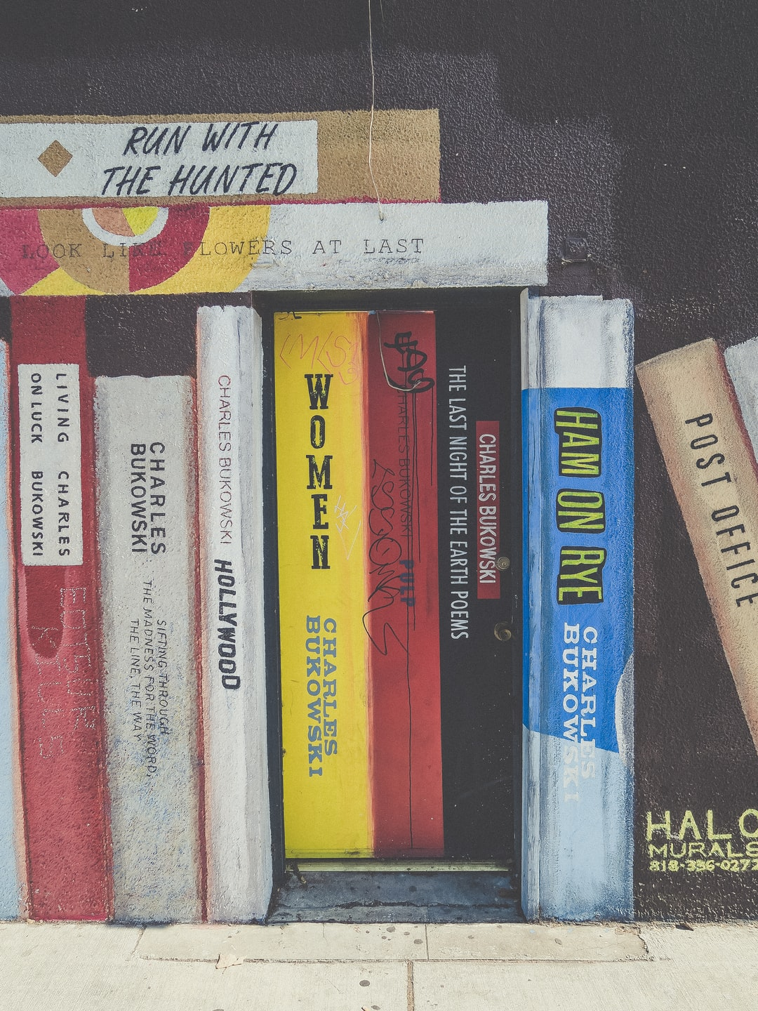 There is a store in Hollywood that has always fascinated me. I have had a lot of wonderful shopping experiences there and they have talked about building a bar in the back related to Charles Bukowski. They put up this mural and for years, it has been so simple, yet so smart to me. I love books and a mural of a bookshelf of your favorite author is such a great idea. I don't own a kindle and have never read a book on my computer. These books might be a great reminder to go to your local library.