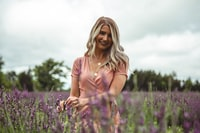 blonde woman in the middle of purple flower field