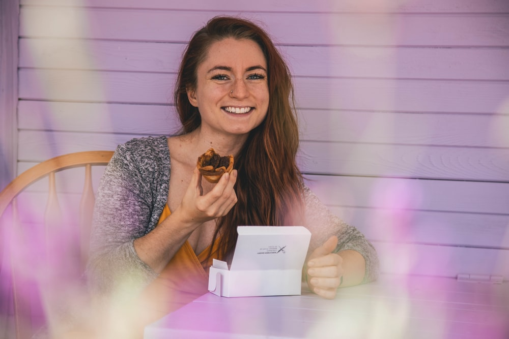 woman eating cupcake