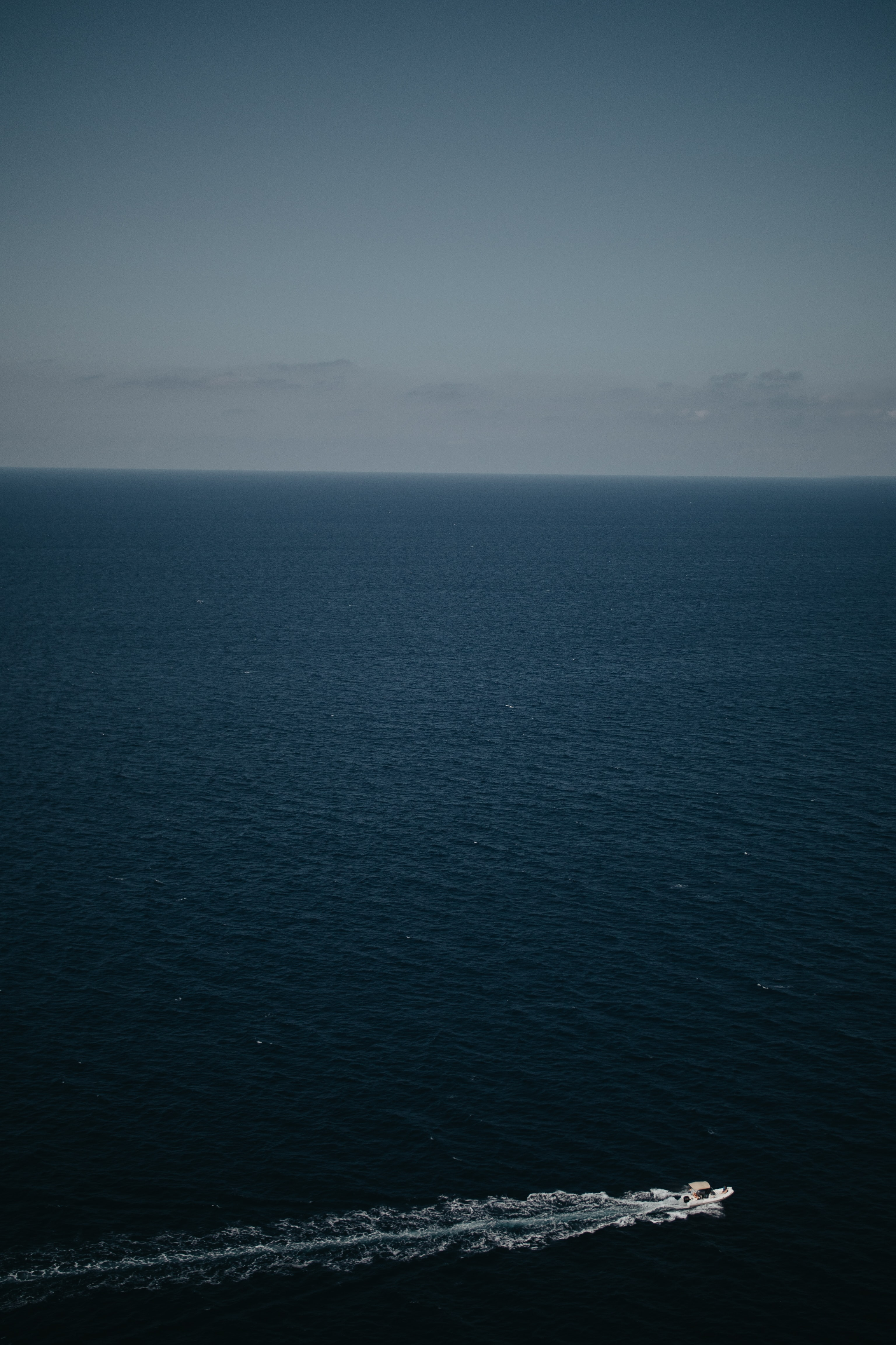 aerial photography sea under blue sky
