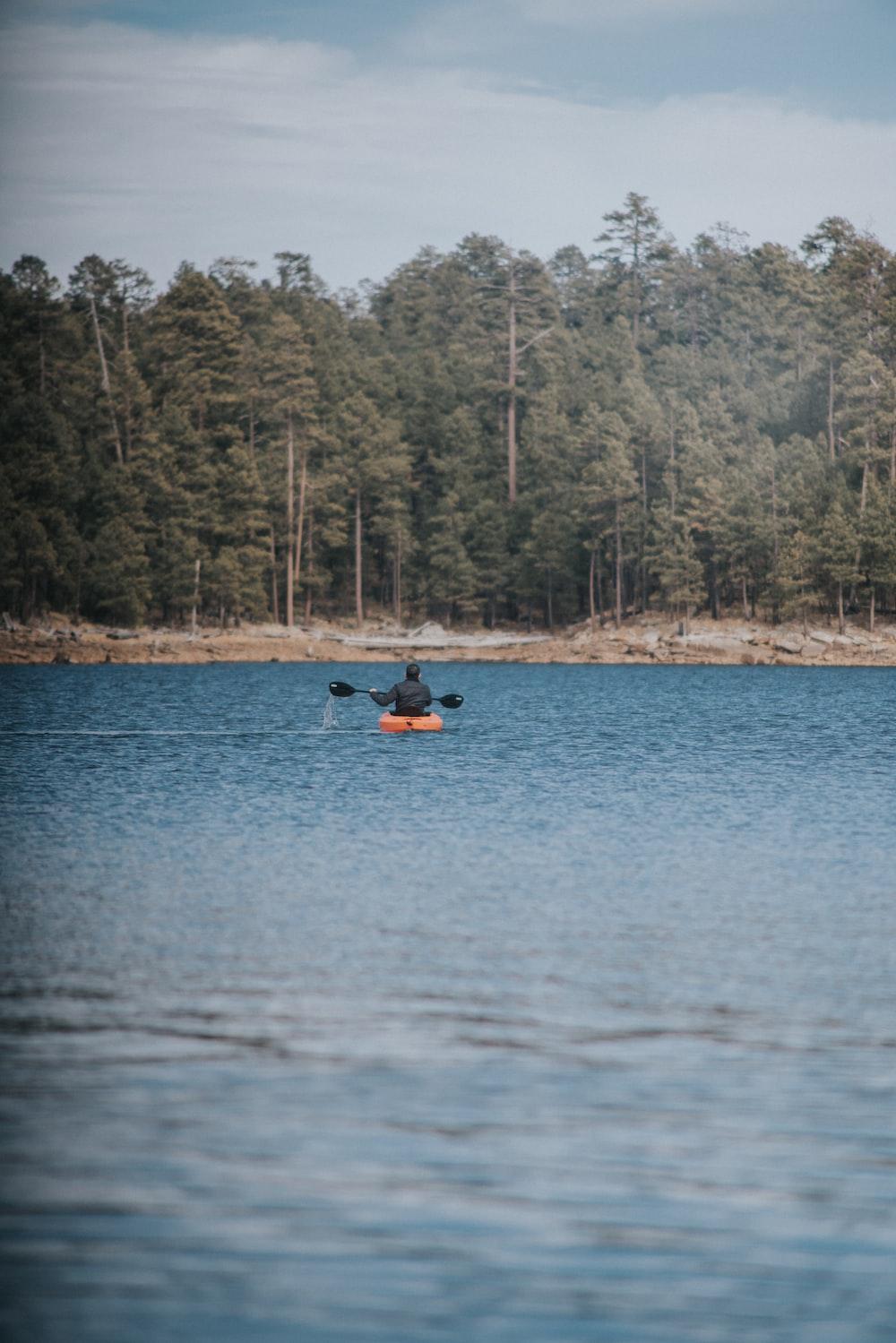 person rowing kayak