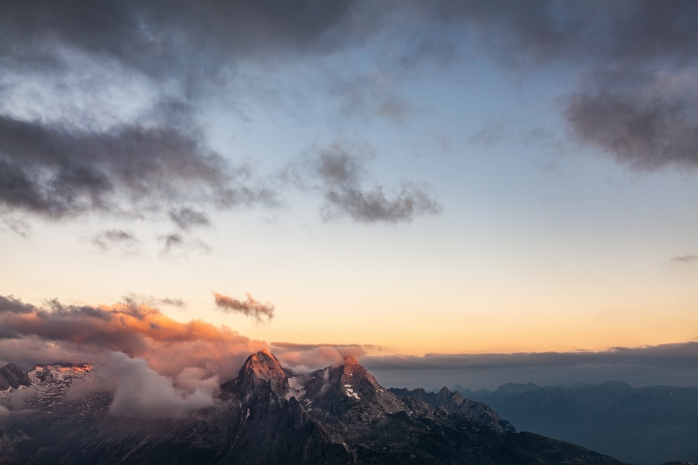 aerial photography of mountain and clouds
