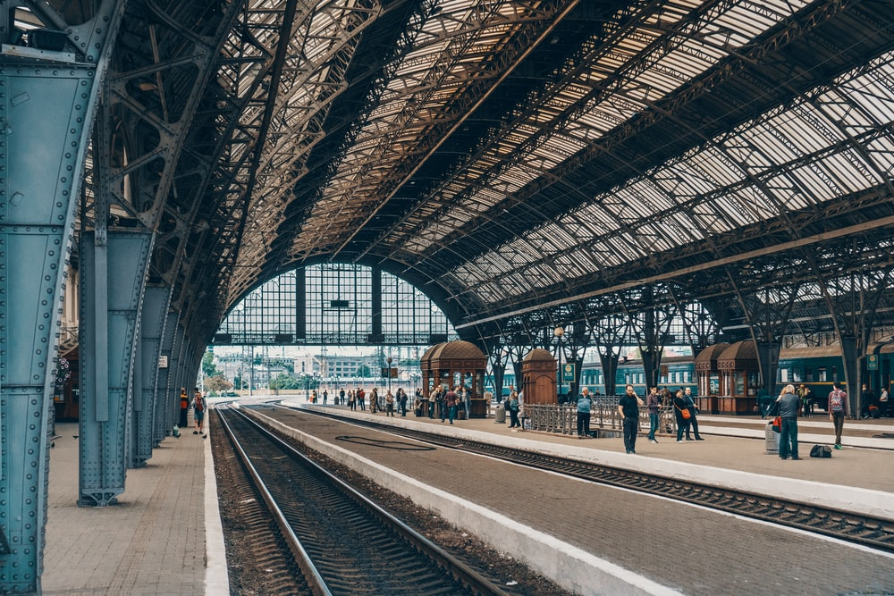 people standing inside gray station during daytime